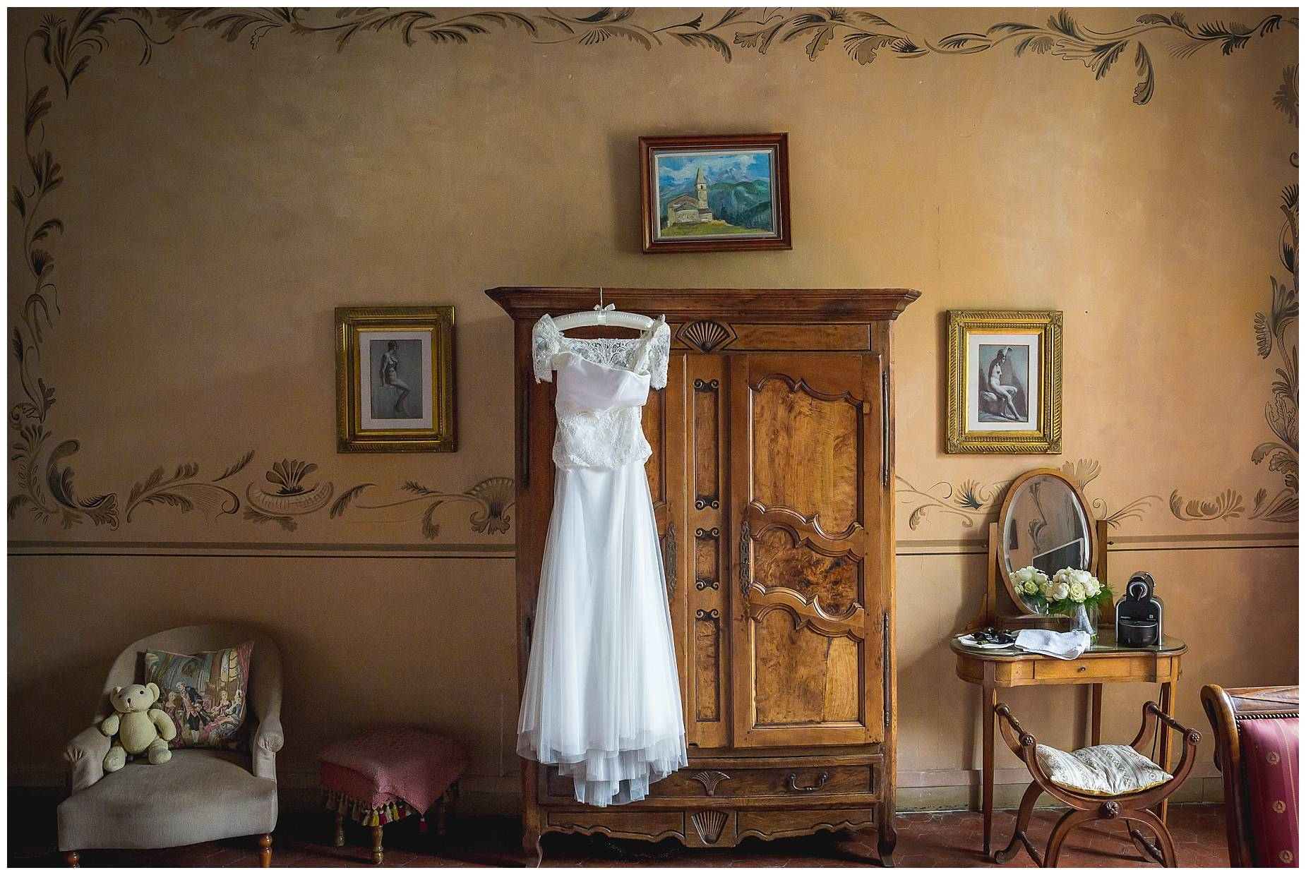brides dress hanging up