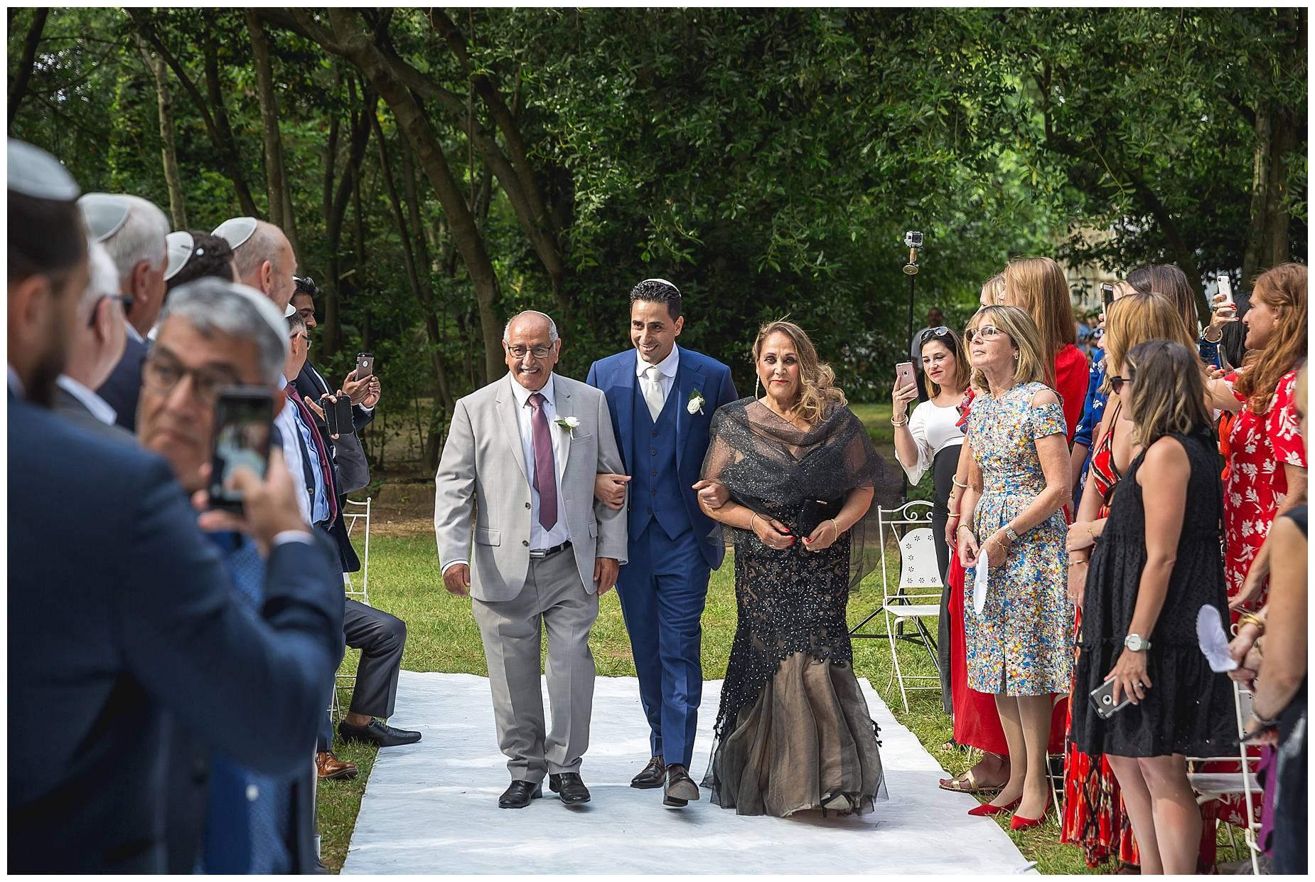 Chateau de Pouget groom walks down the aisle with parents