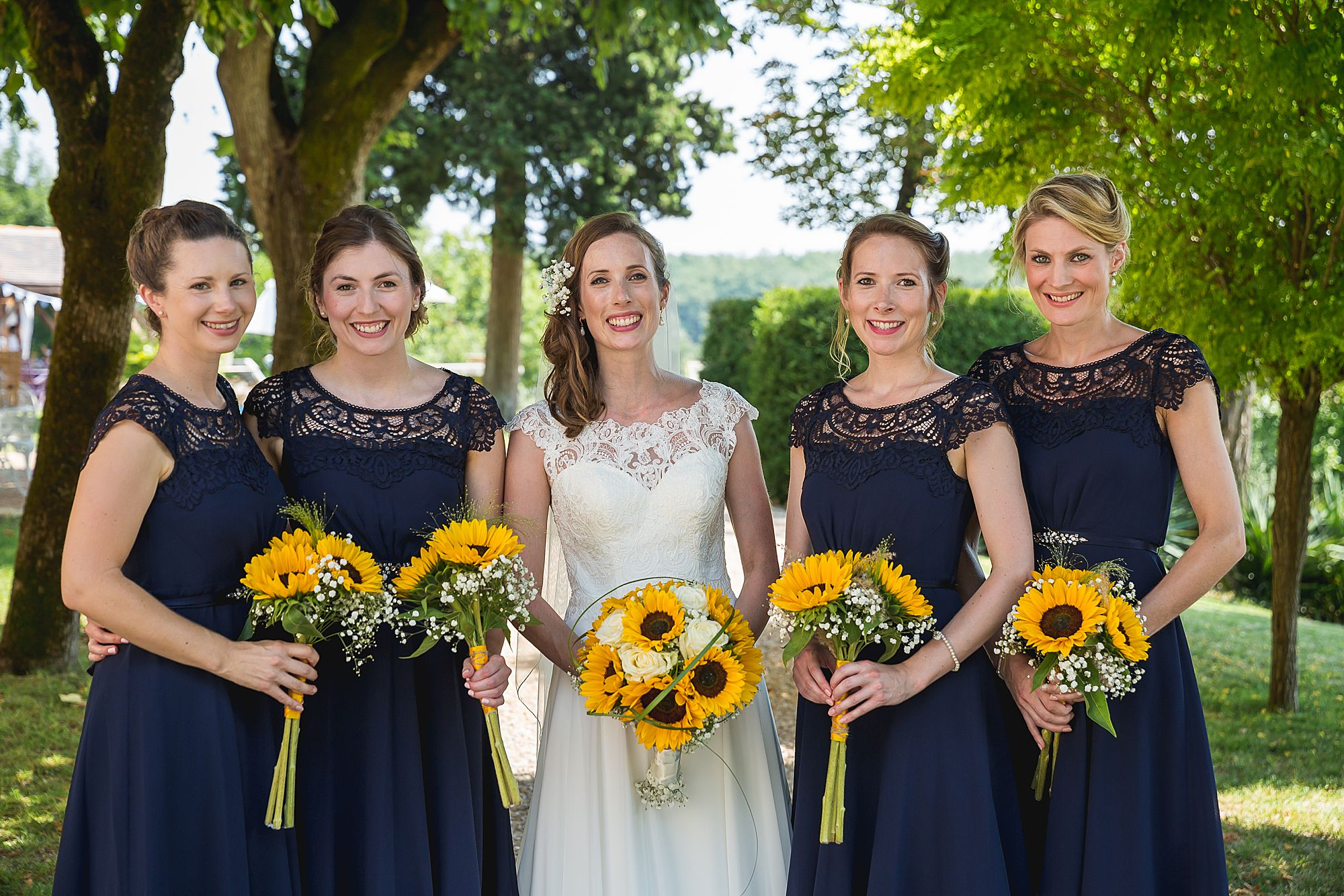 bridesmaids with sunflowers and blue dress