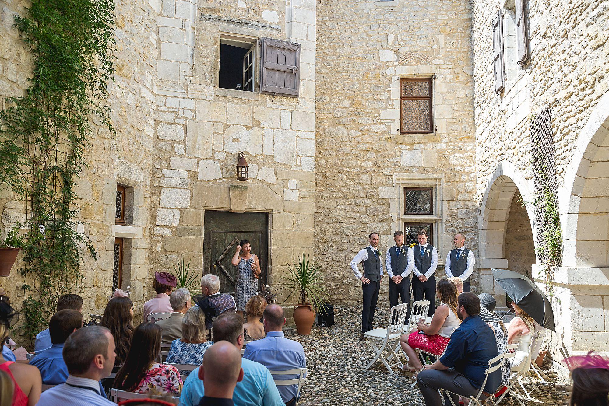 groom waits for the Chateau Brametourte wedding to start