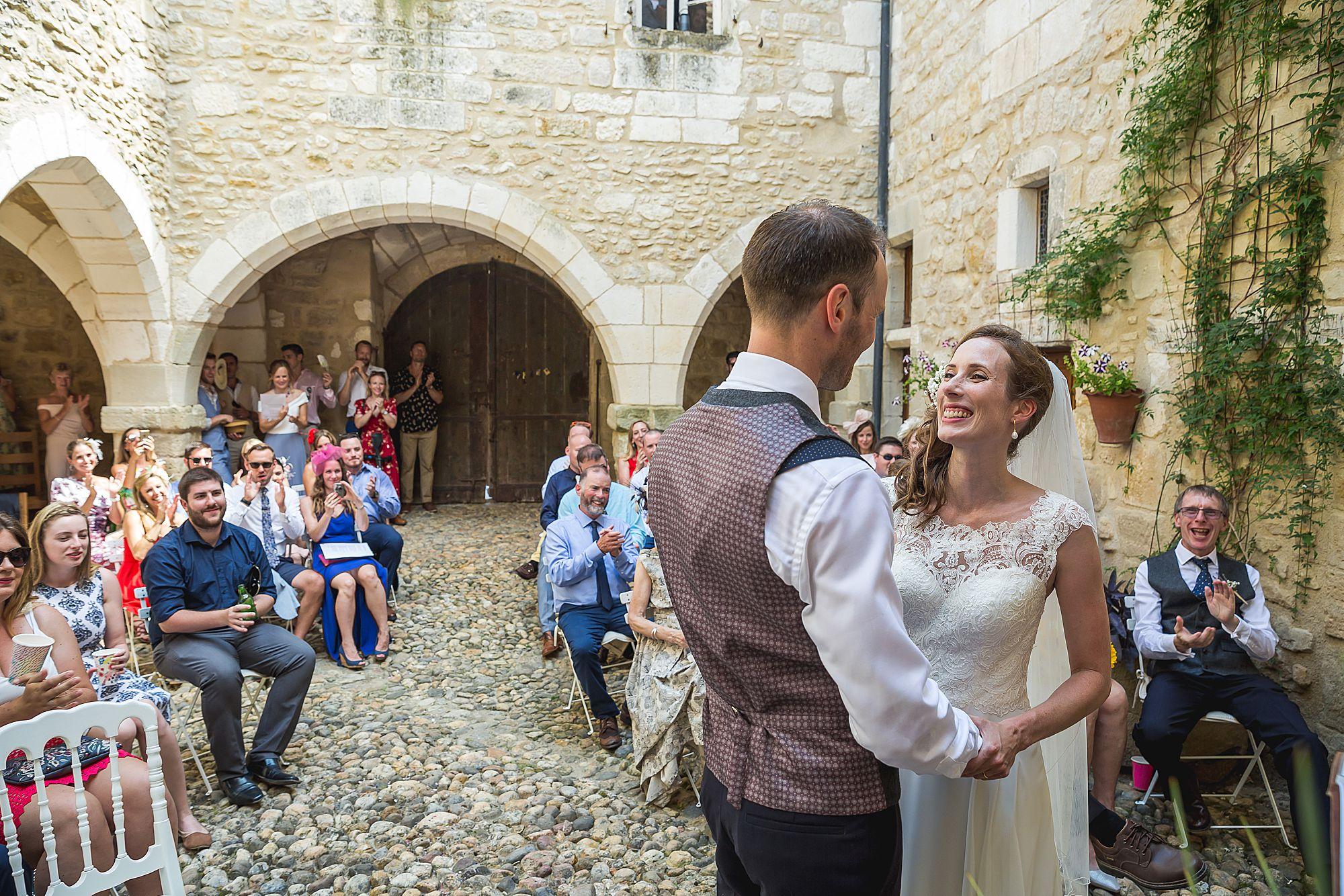 bride smiles at groom