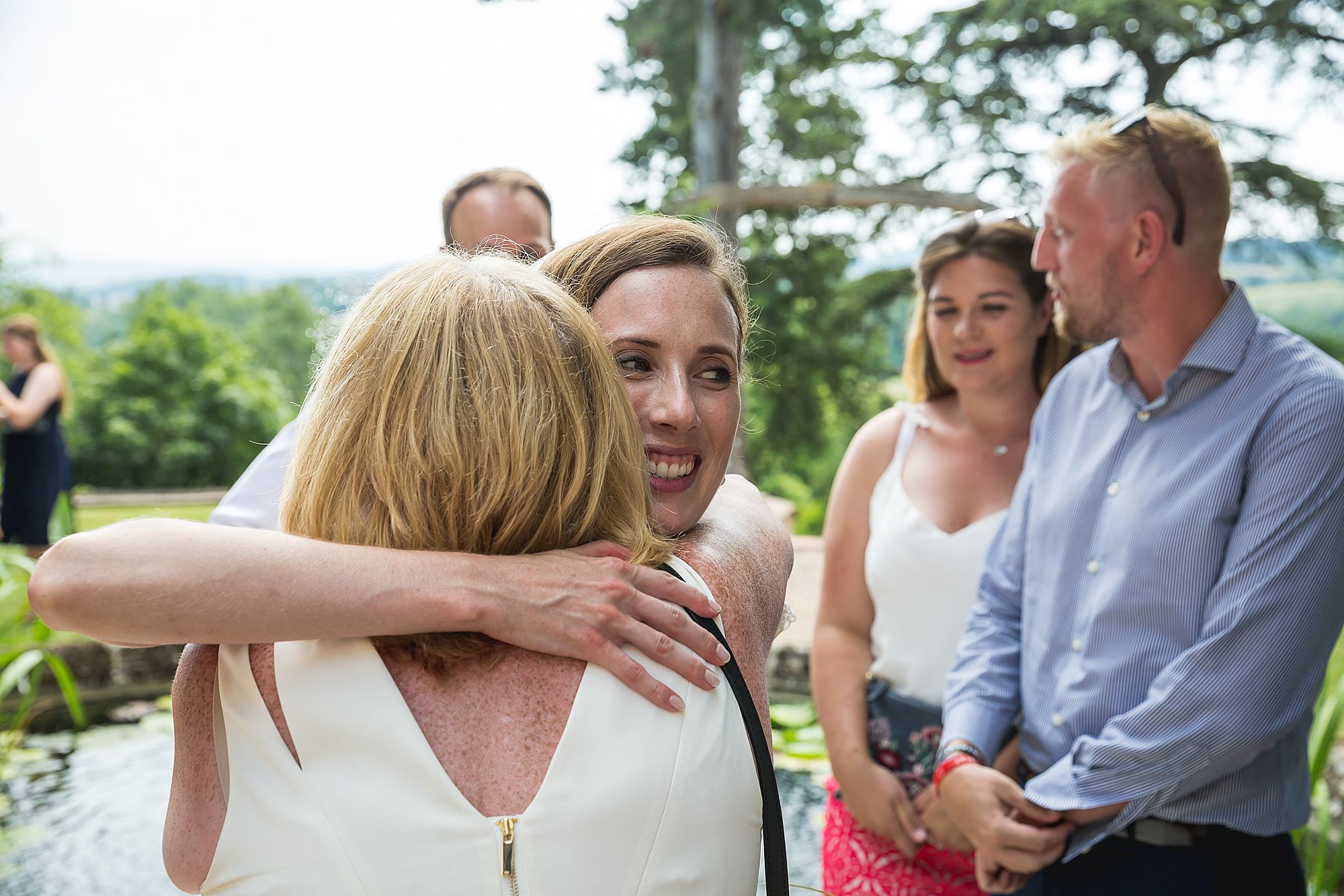 bride hugs another guest