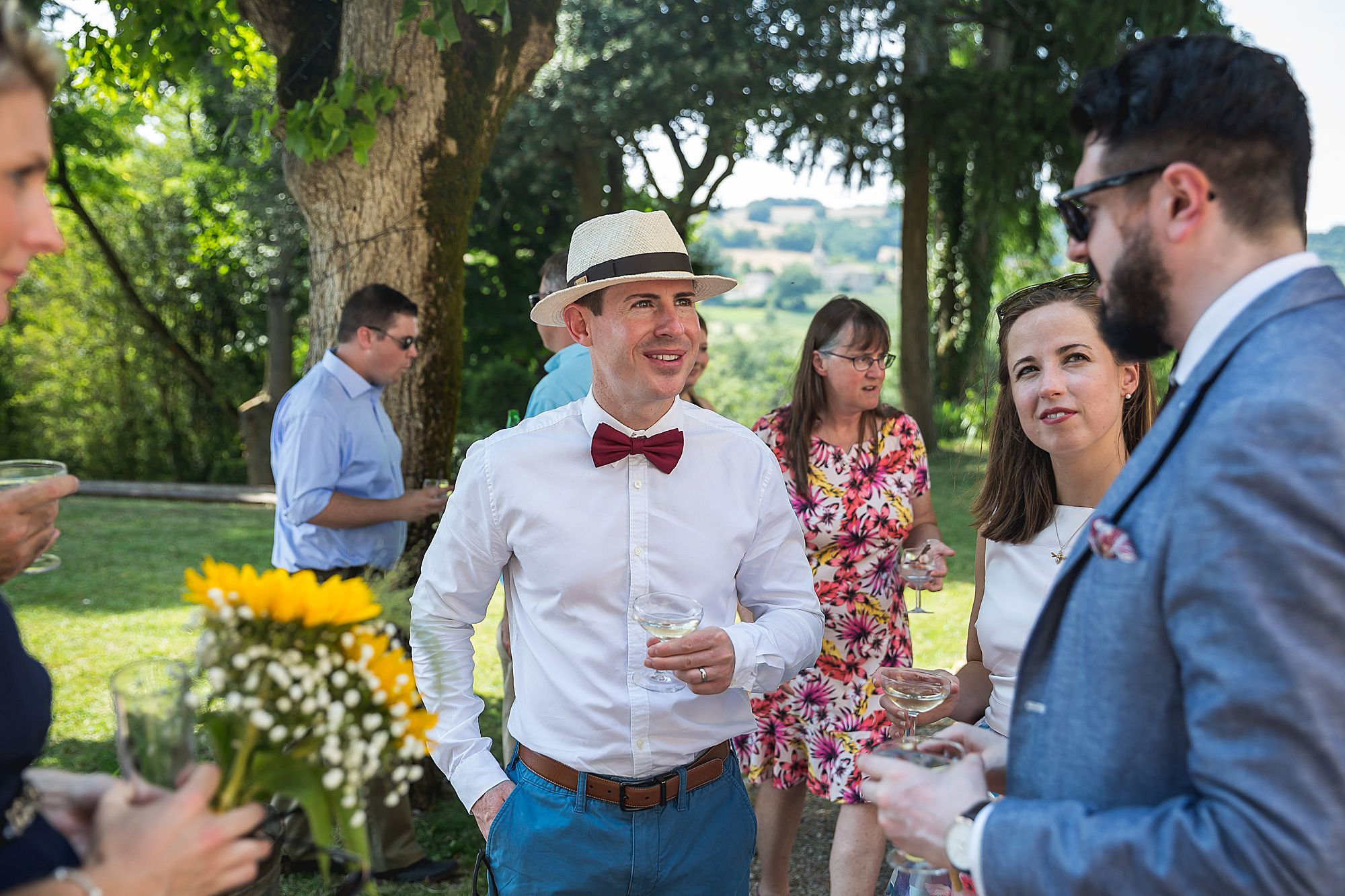 guy in bow tie and hat