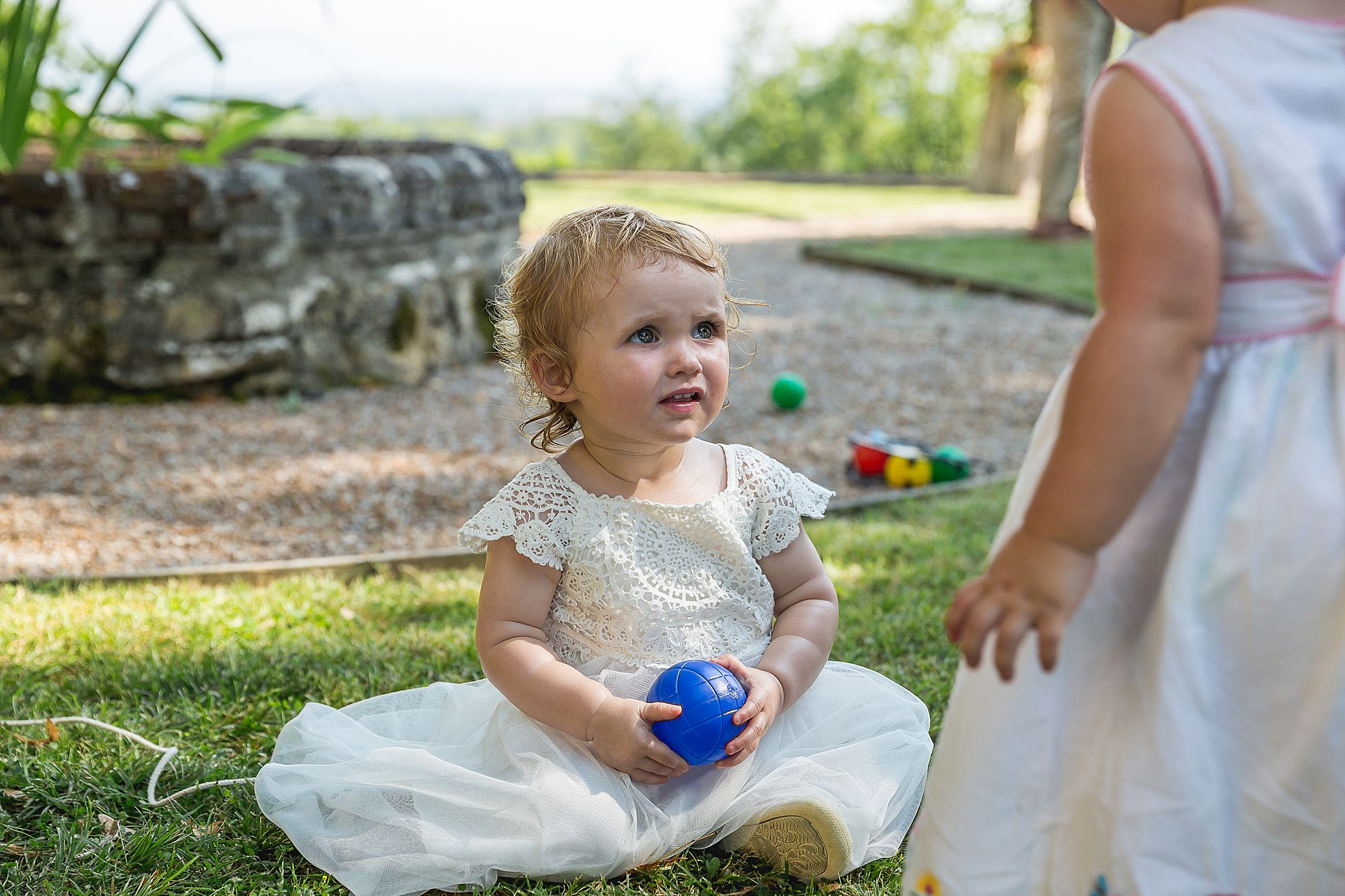 little girl with blue ball