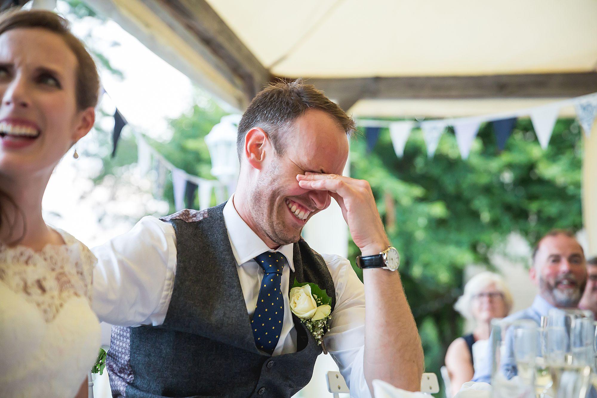groom looks very embarrassed