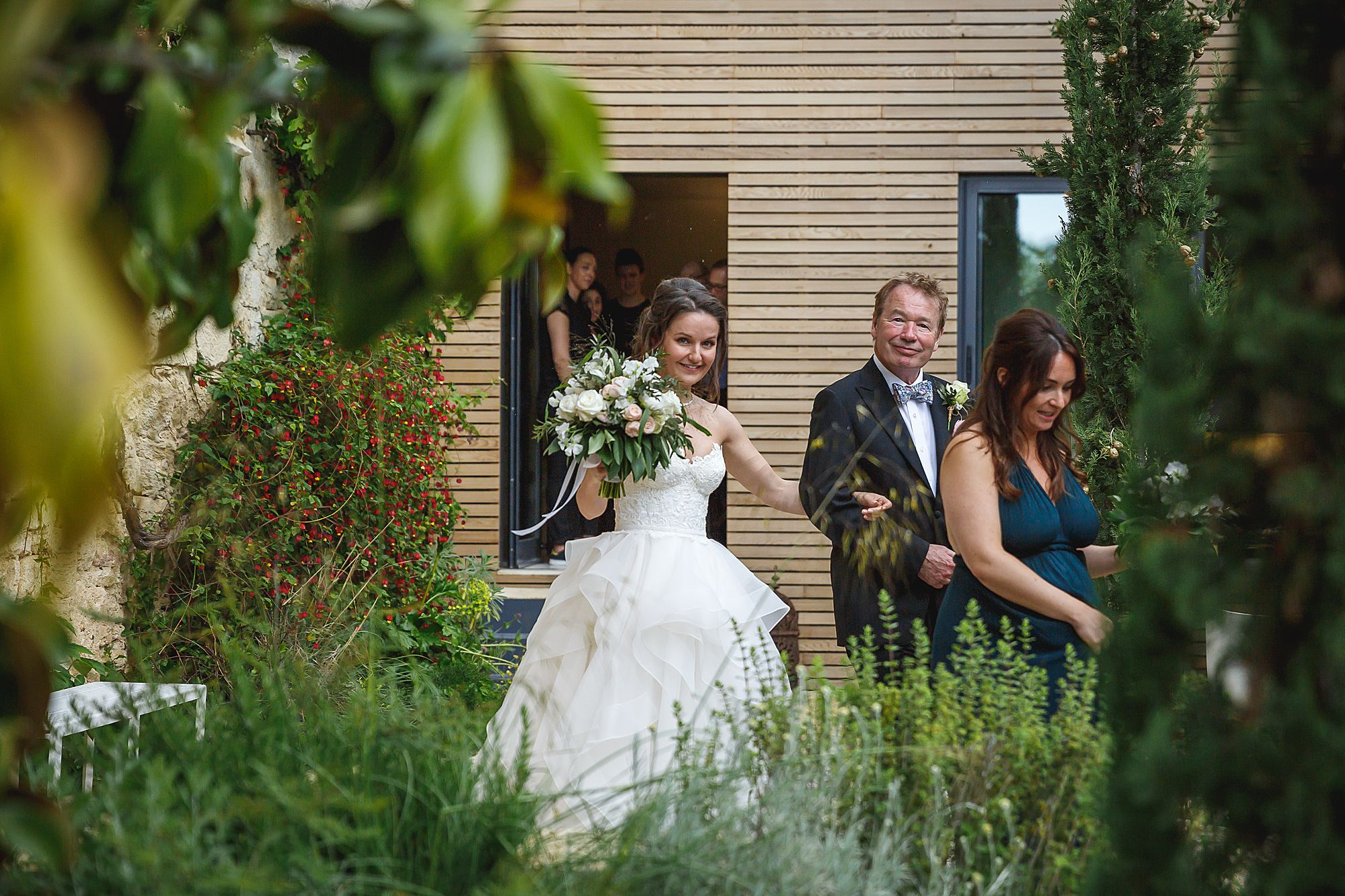 bride makes her way to the ceremony Chateau Provence wedding