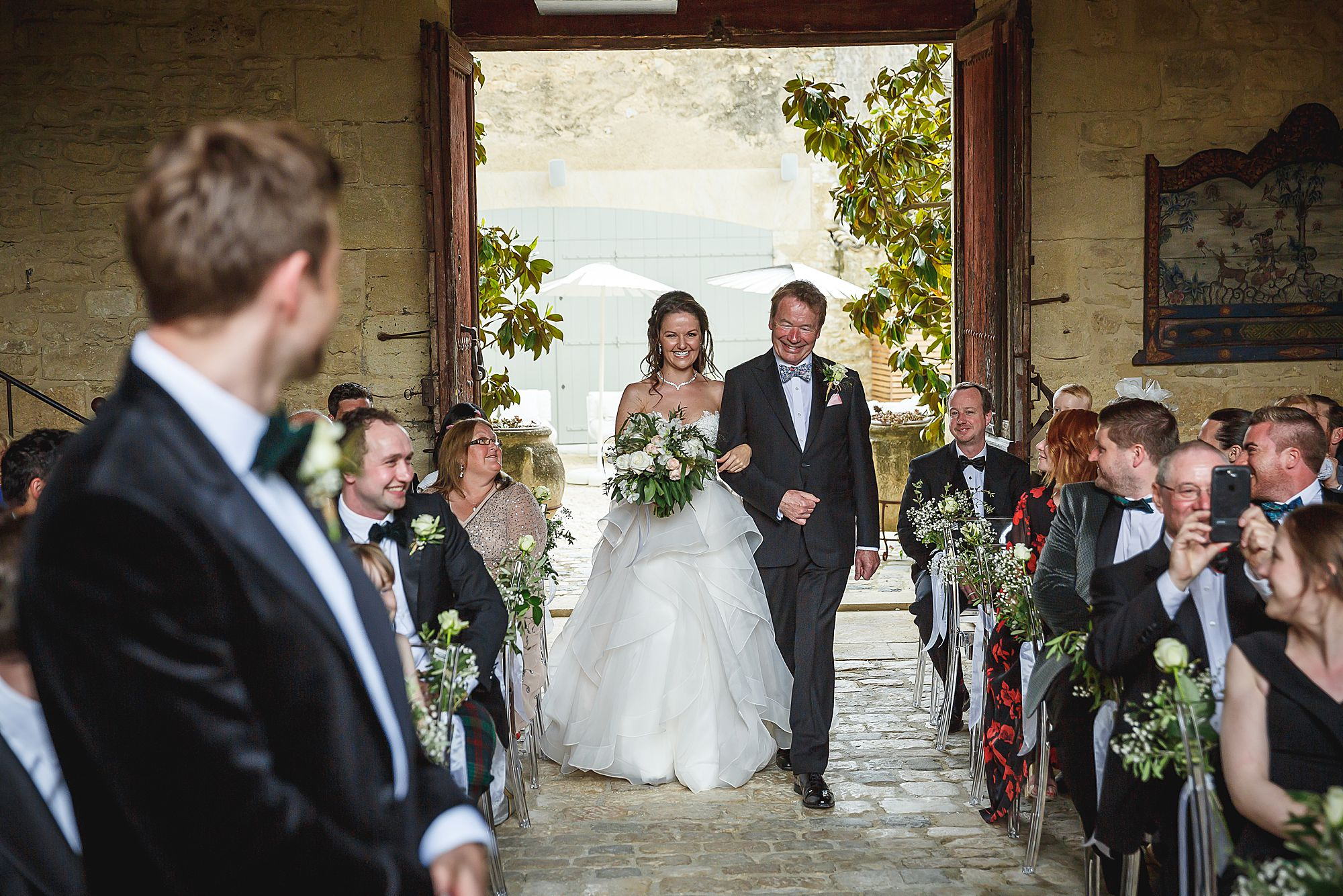bride walks down the aisle at Chateau Provence wedding