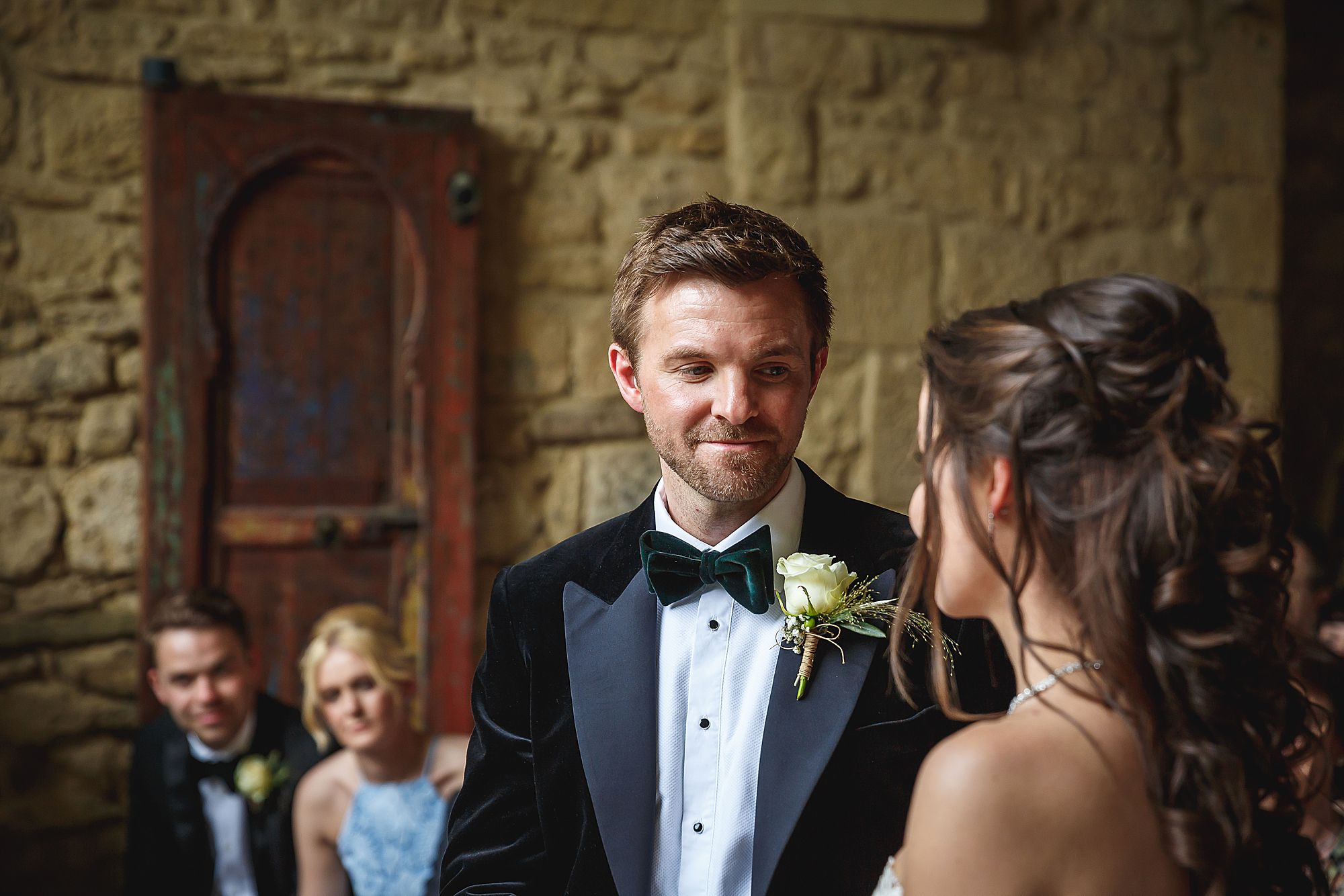 groom looks at bride
