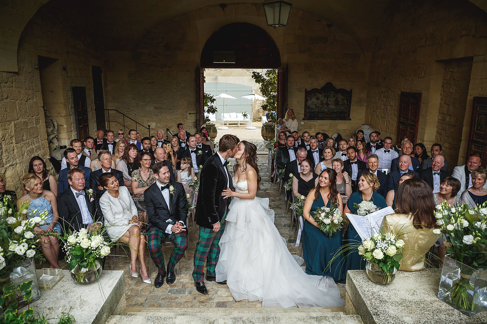 kiss at Chateau Provence wedding