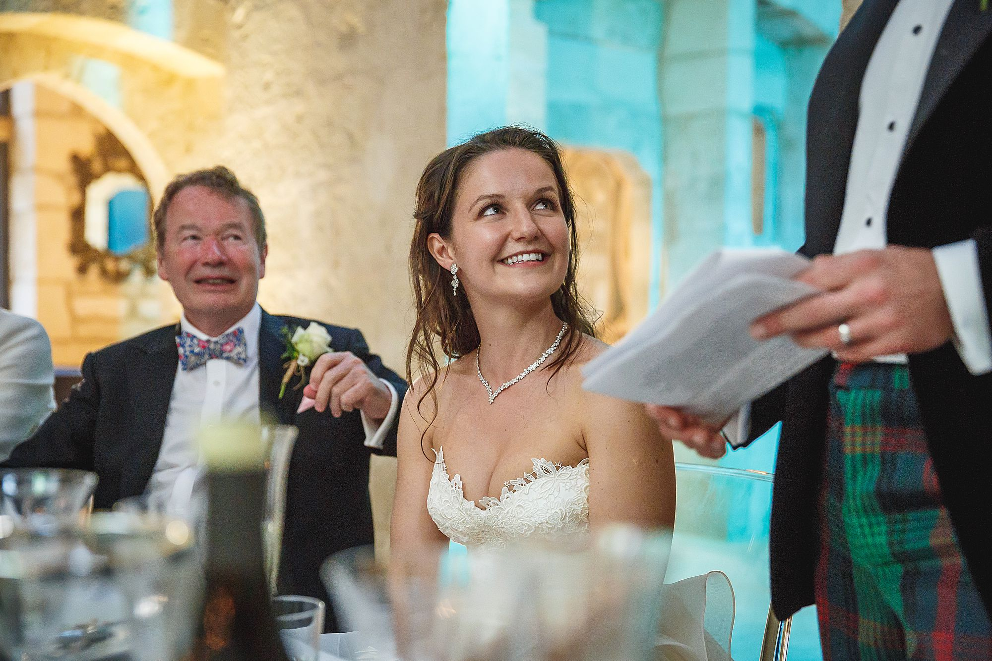bride listens to groom speech