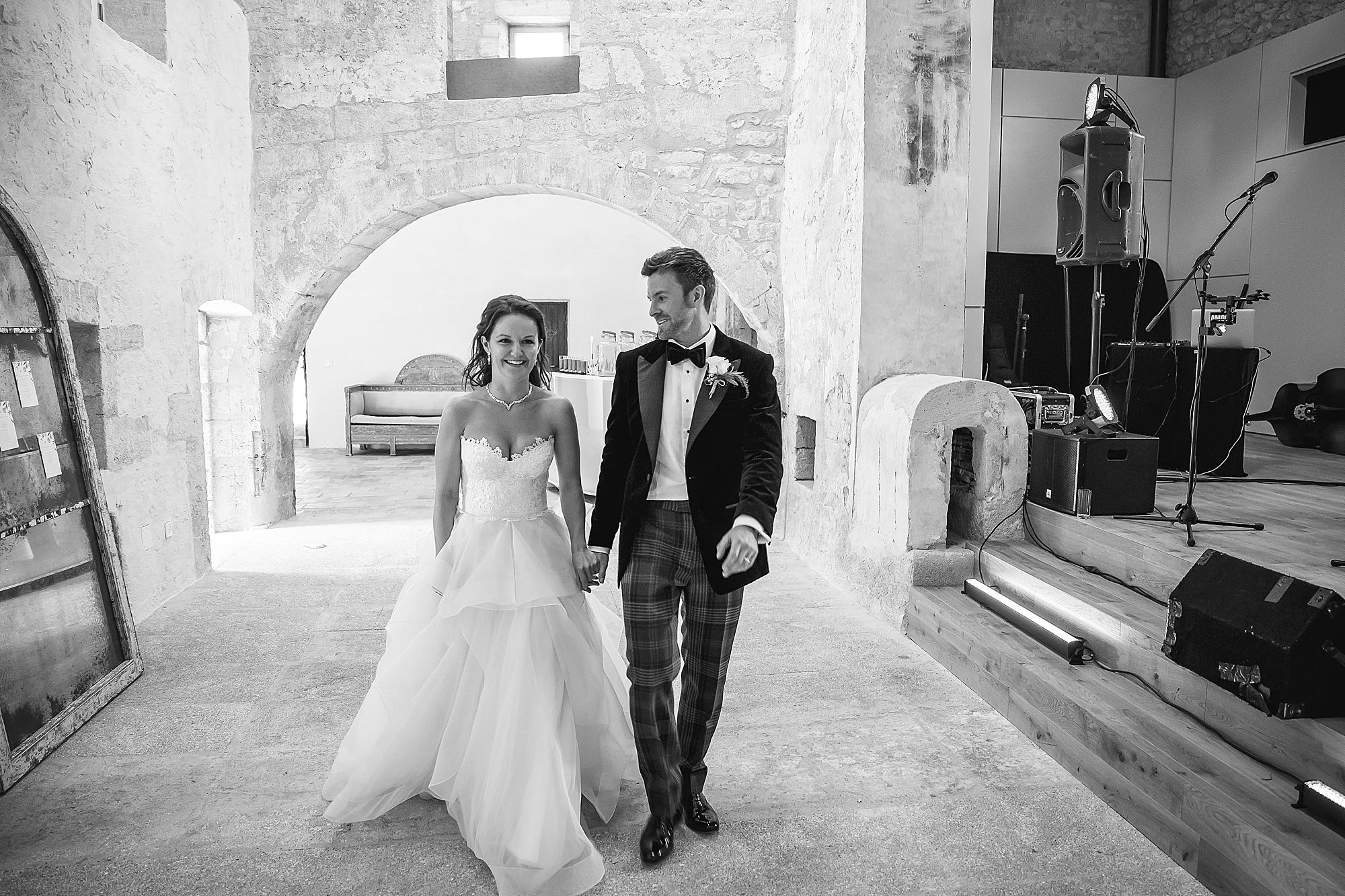 bride and groom enter Chateau Provence wedding