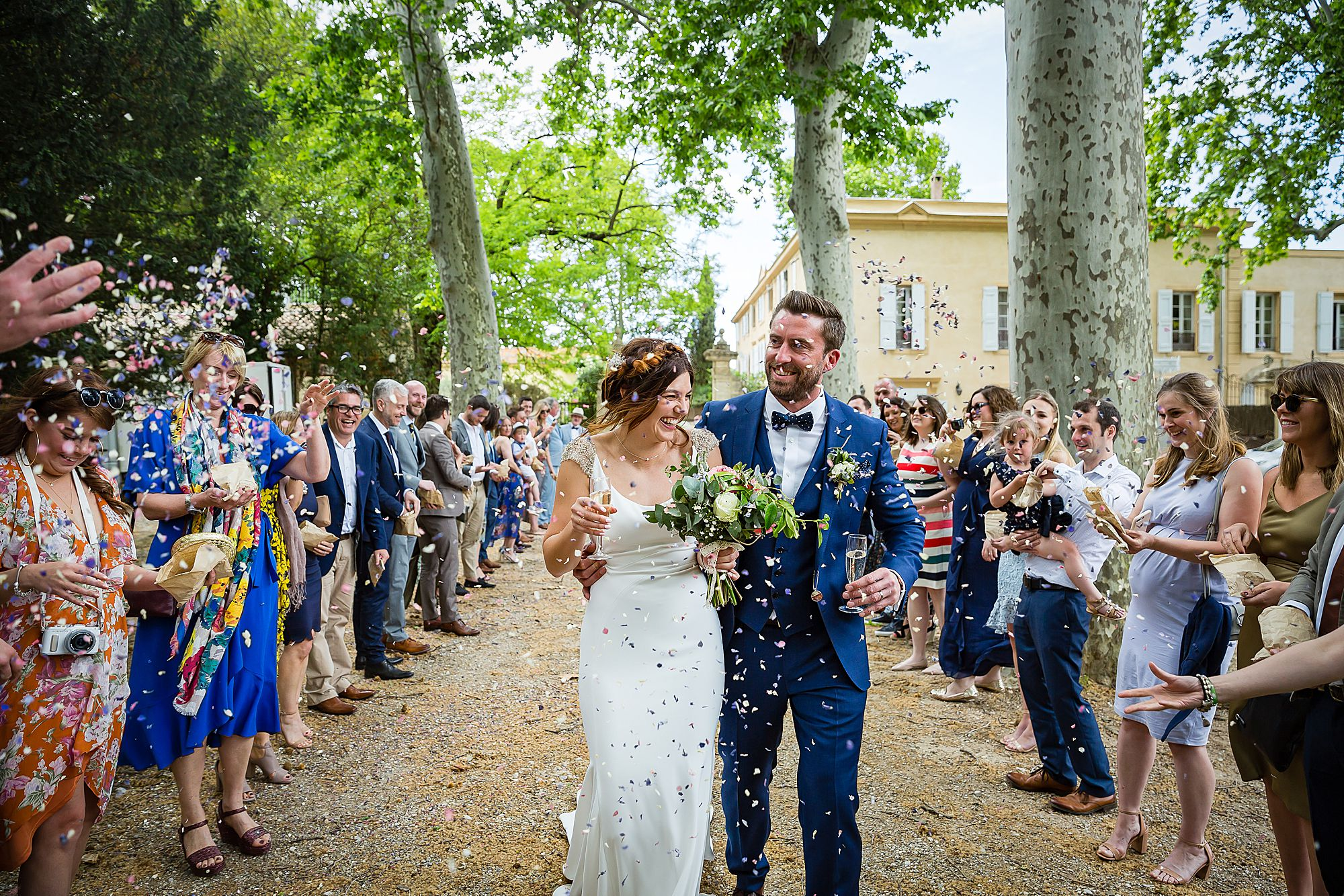 couple in confetti Chateau Rieutort wedding