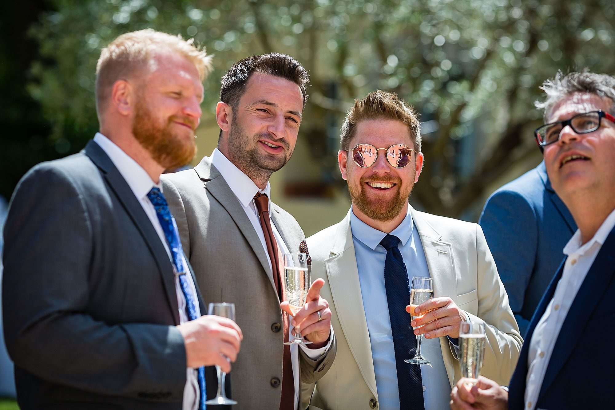 three guys in shades at Chateau Rieutort wedding