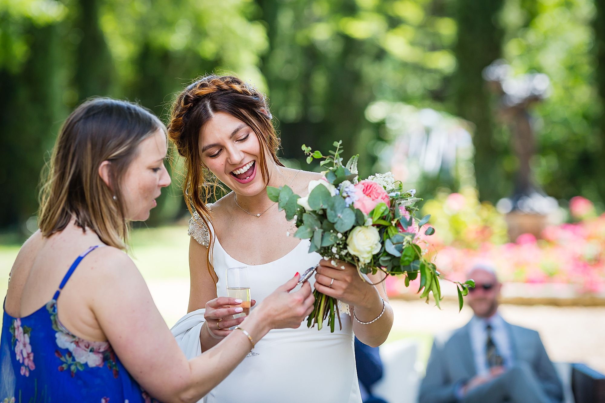 bride shares a locket on her bouquet at Chateau Rieutort wedding