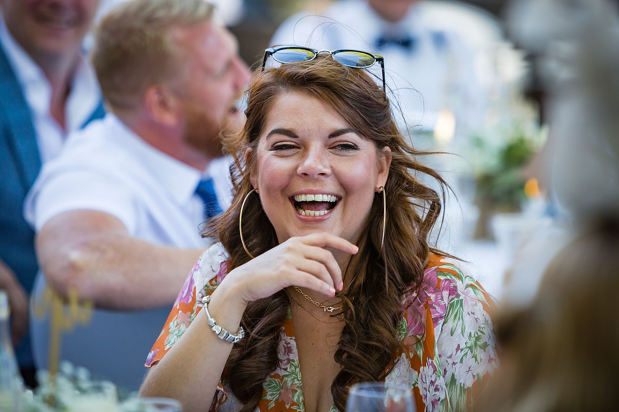 woman laughs at Chateau Rieutort wedding