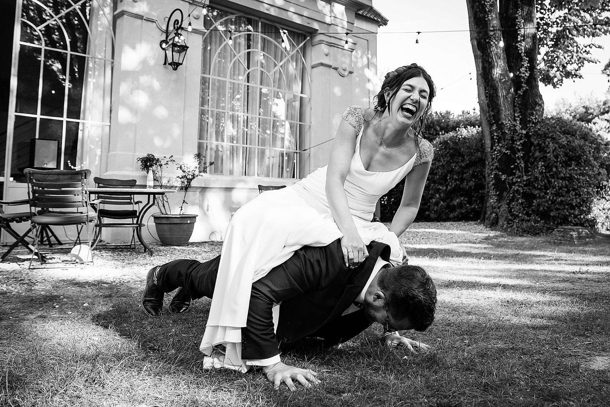 groom does press ups with the bride on his back.