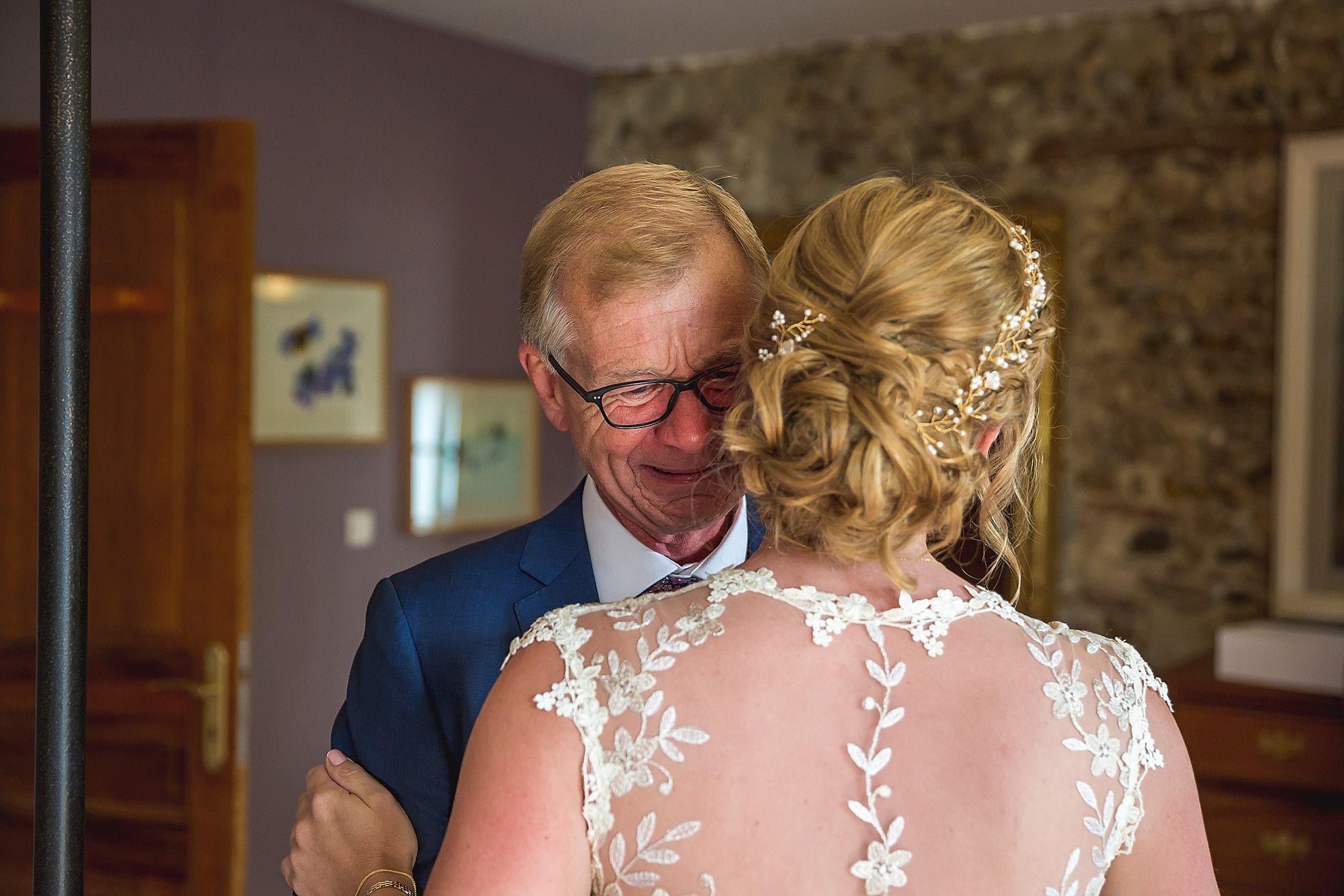Dad hugs bride