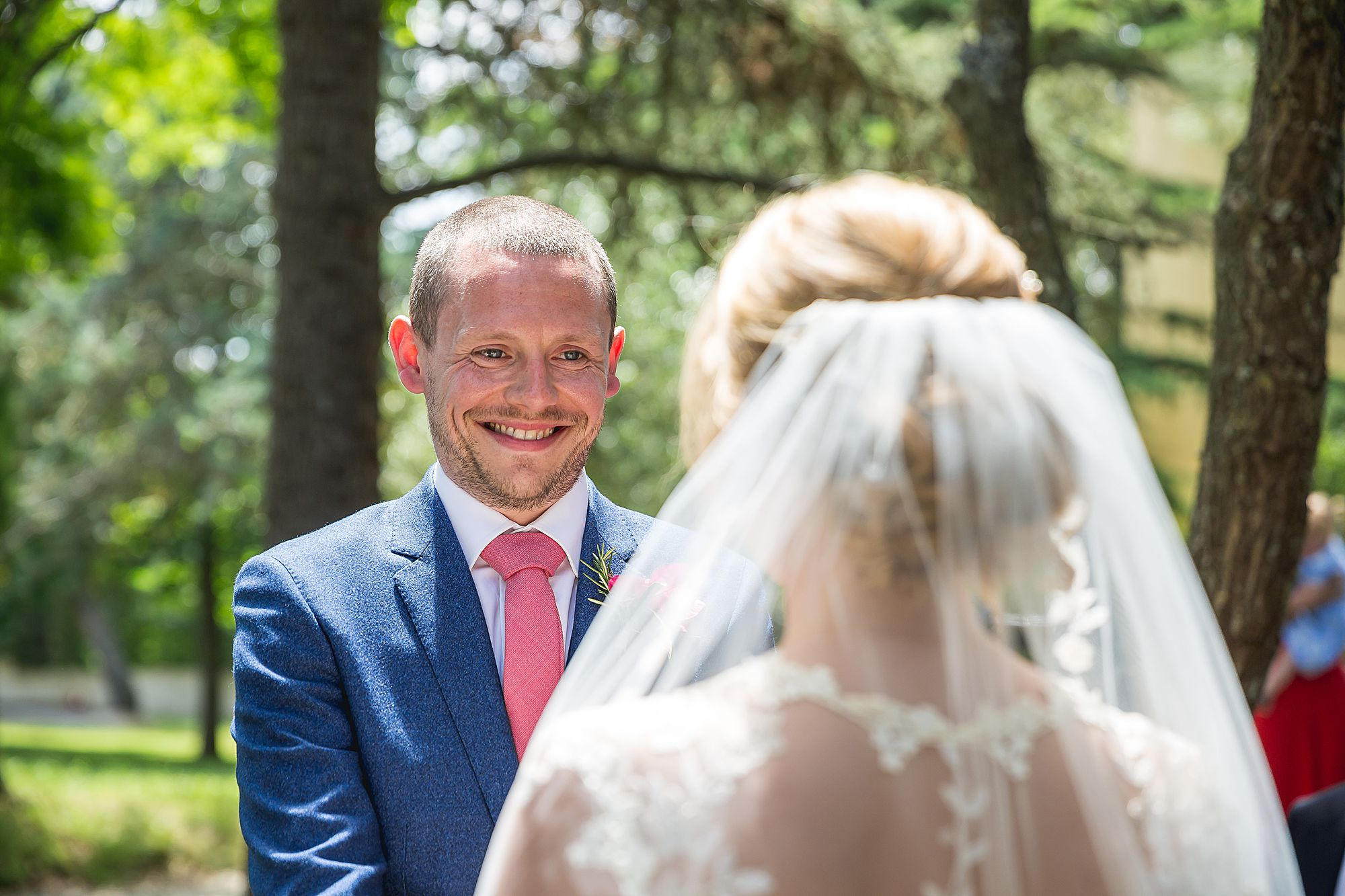 groom smiles at bride