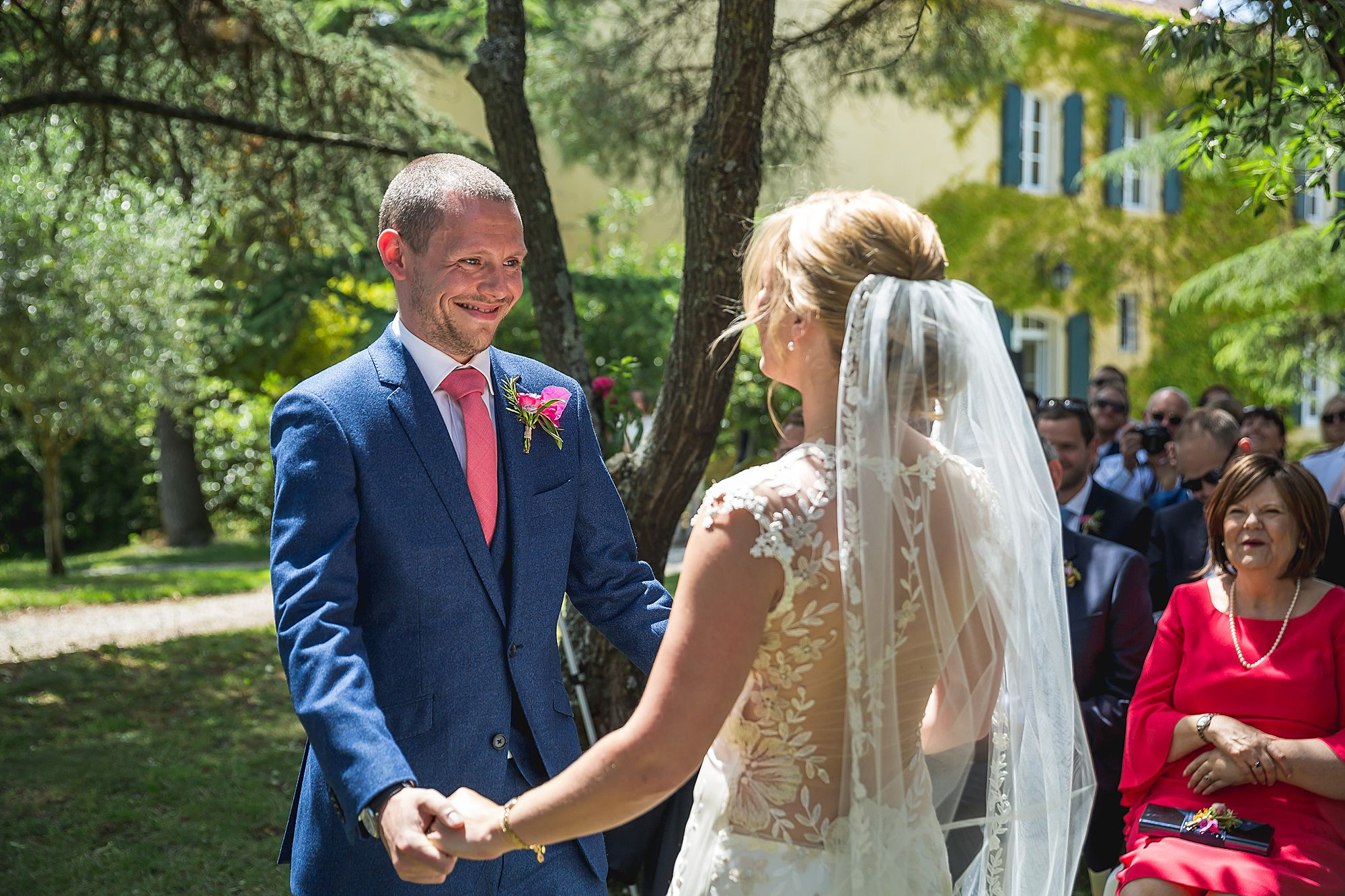 Domaine Gayda wedding groom holds brides hand
