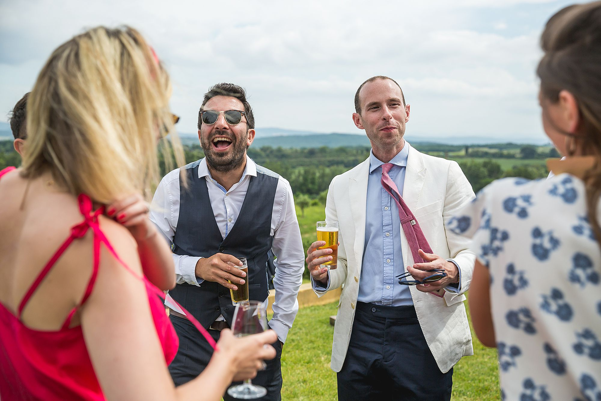 guests laughing at Domaine Gayda wedding