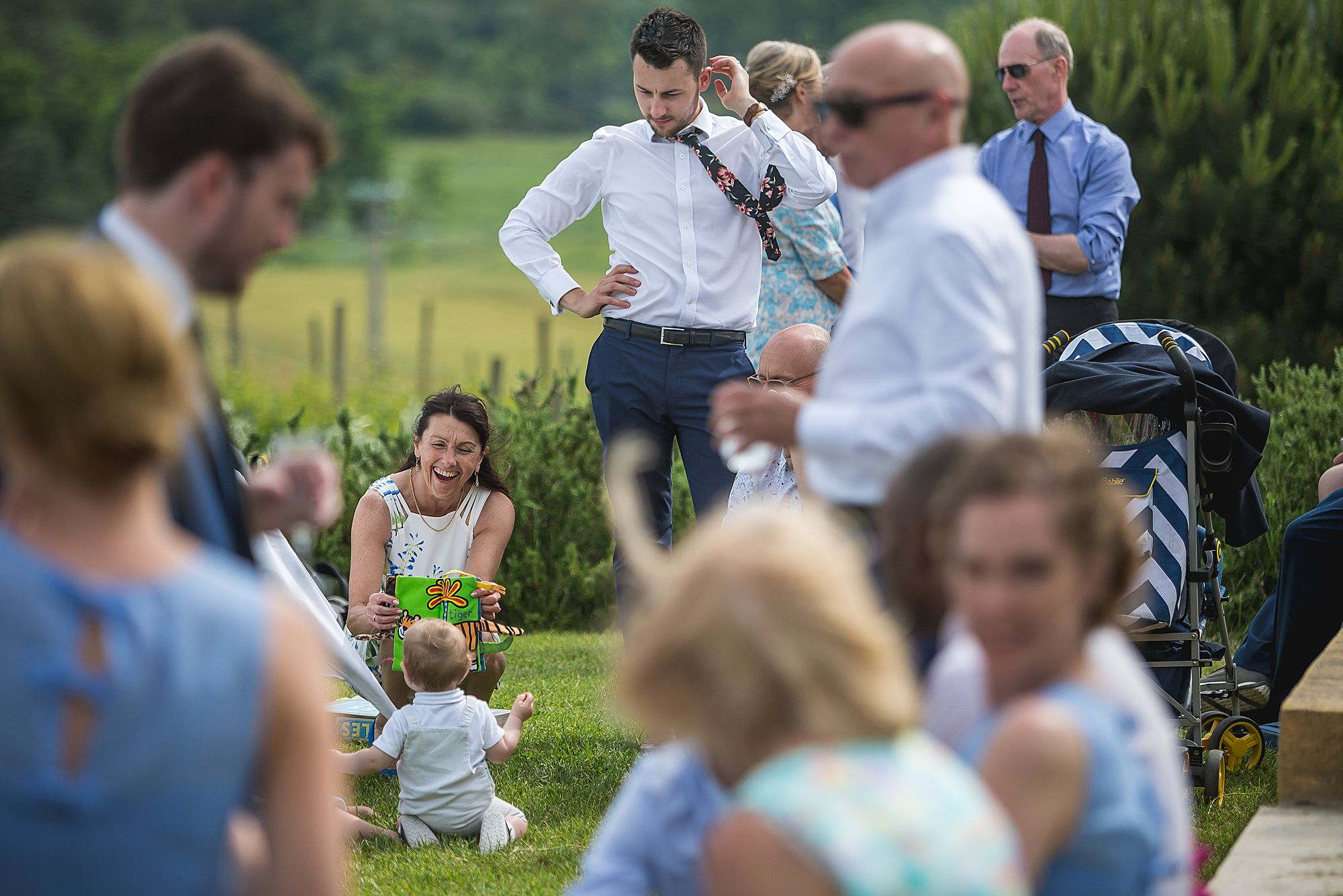 woman plays with baby at Domaine Gayda wedding