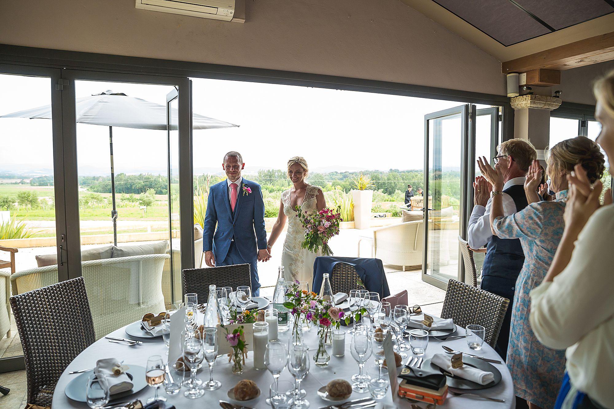Domaine Gayda wedding couple enter wedding breakfast