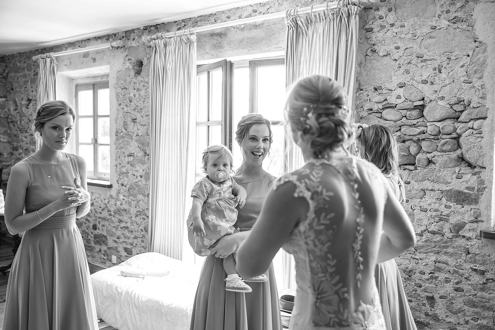 girls look at bride