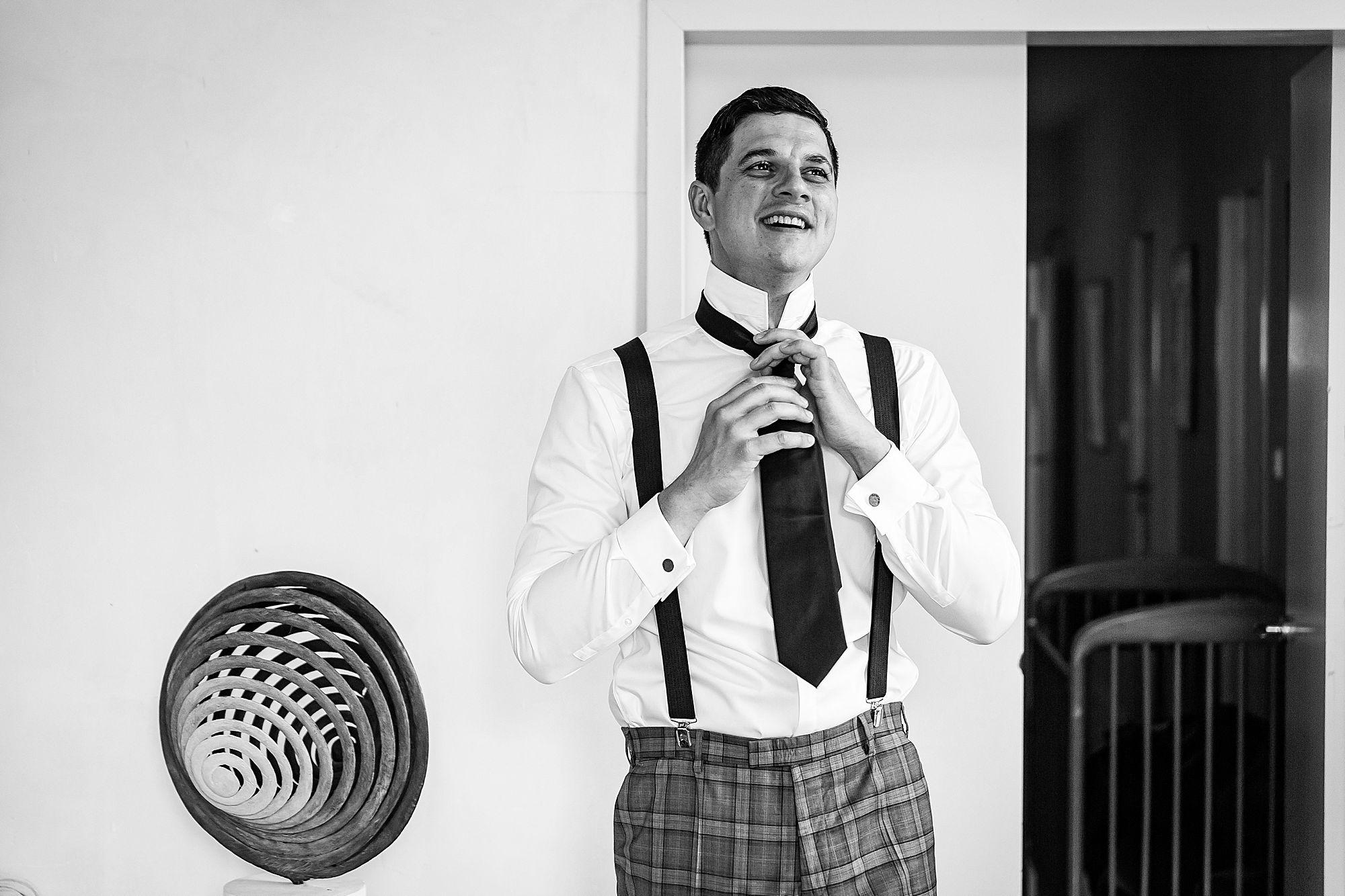 groom does up tie
