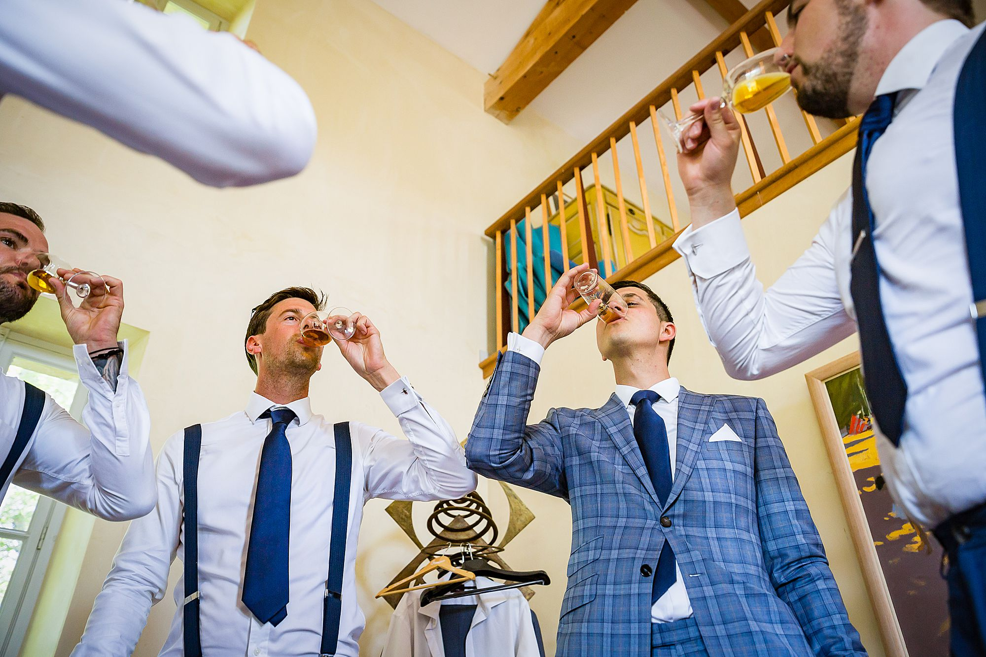 groom and groomsmen drink shots