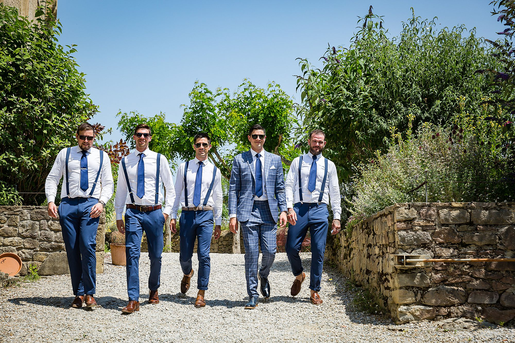 boys walking at Chateau de Queille Wedding