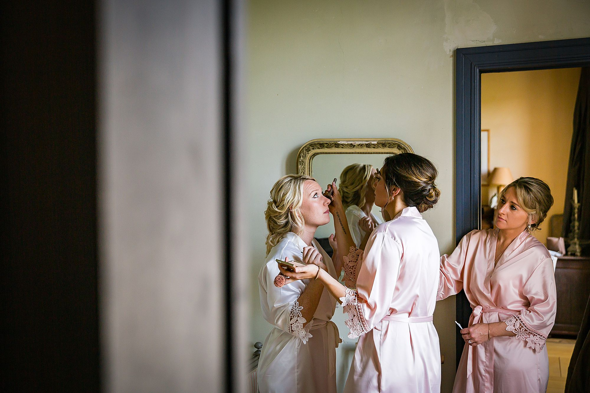 girls help bride get ready Chateau de Queille Wedding