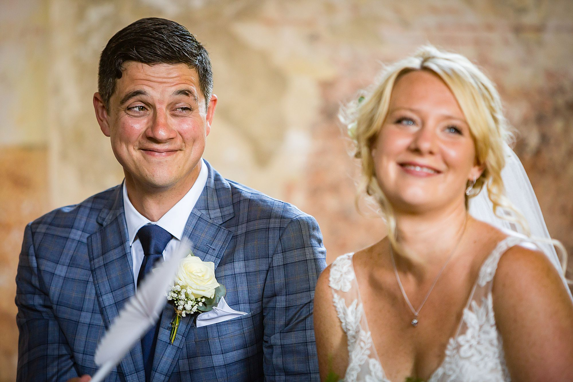 groom smiles at bride.