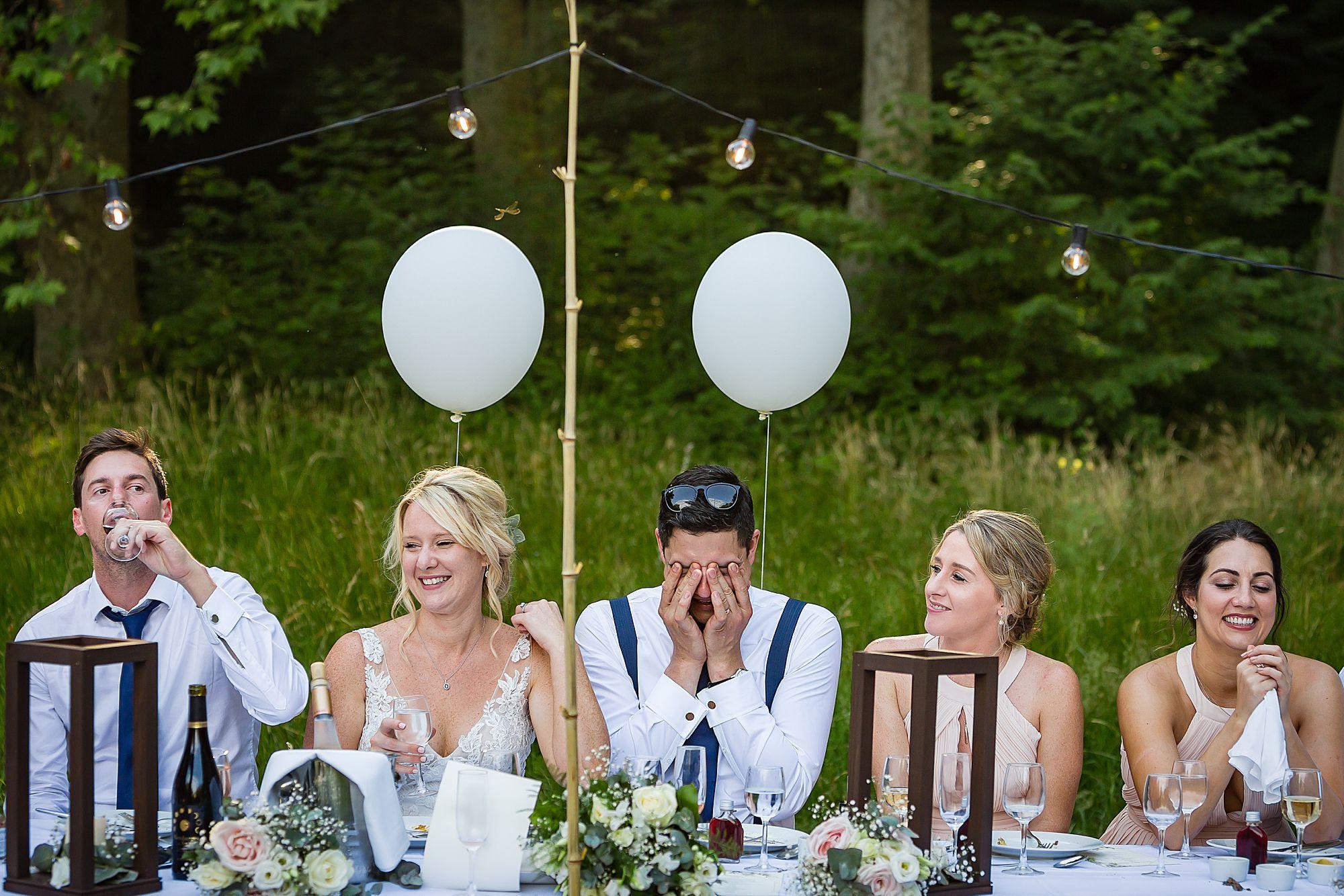 groom looks embarrassed
