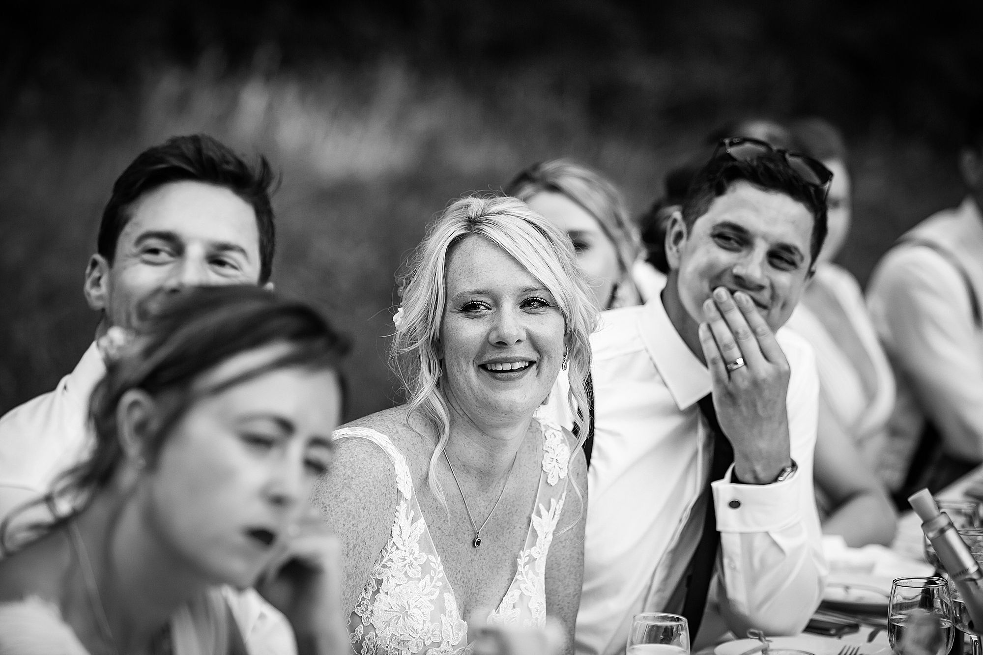 bride smiles at speech