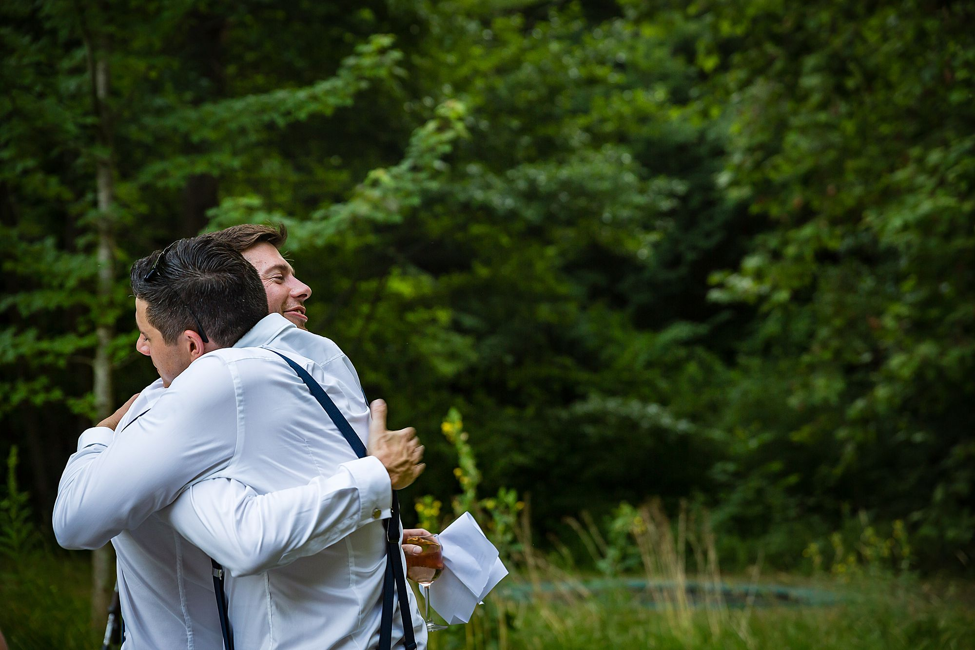 groom hugs friend