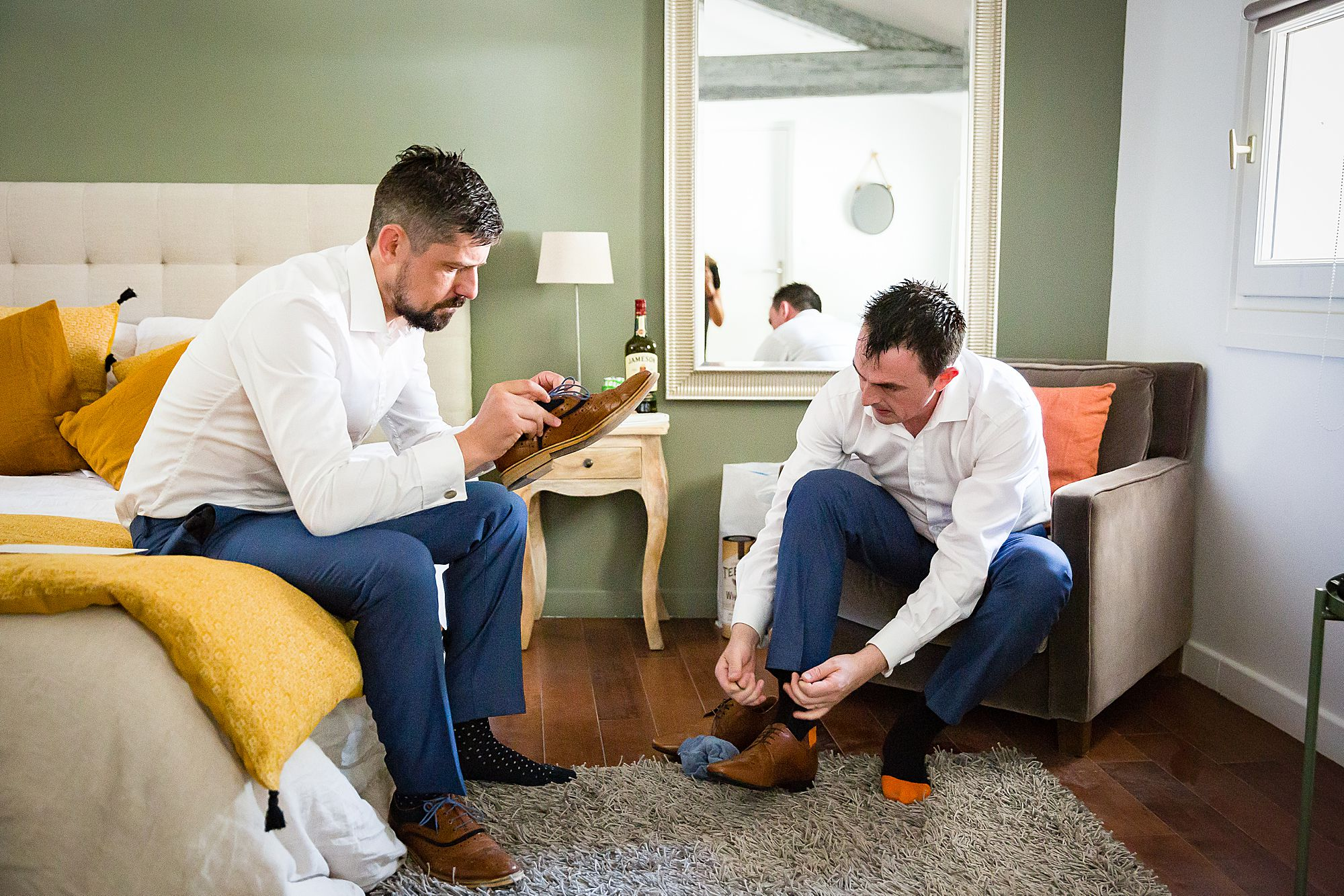 The groomsmen put on shoes