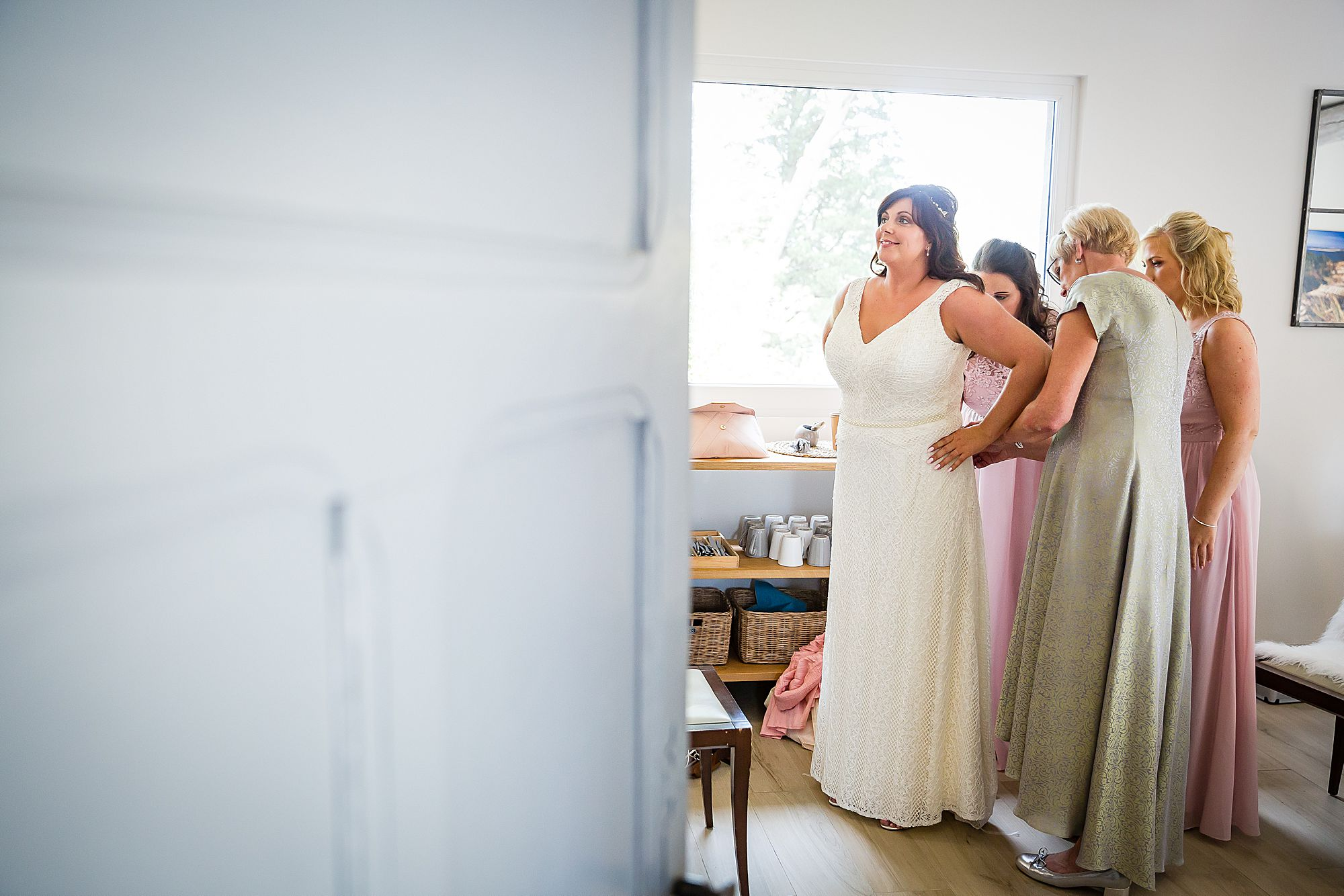 putting on wedding gown for Domaine de la Grangette wedding
