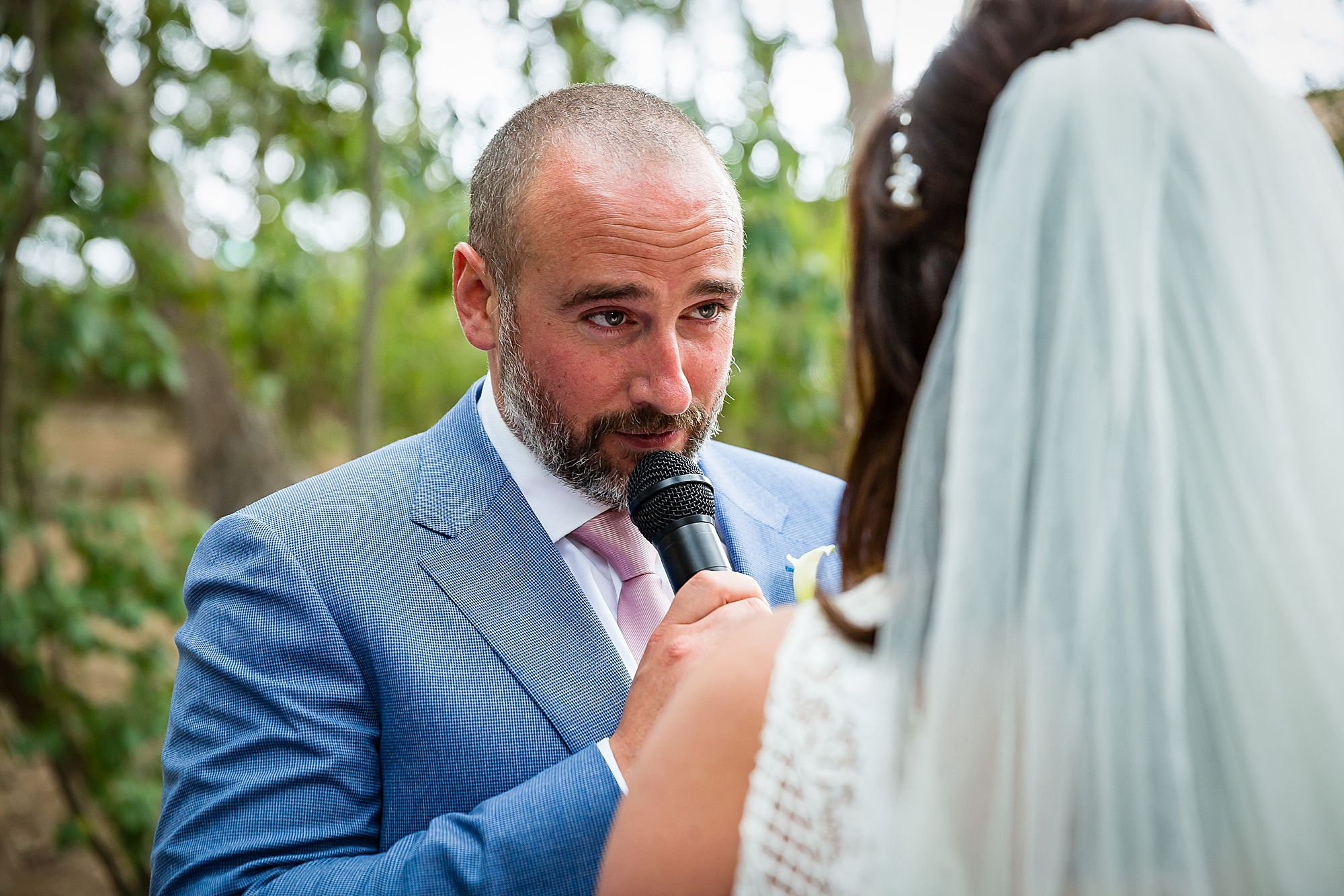 groom talks to bride