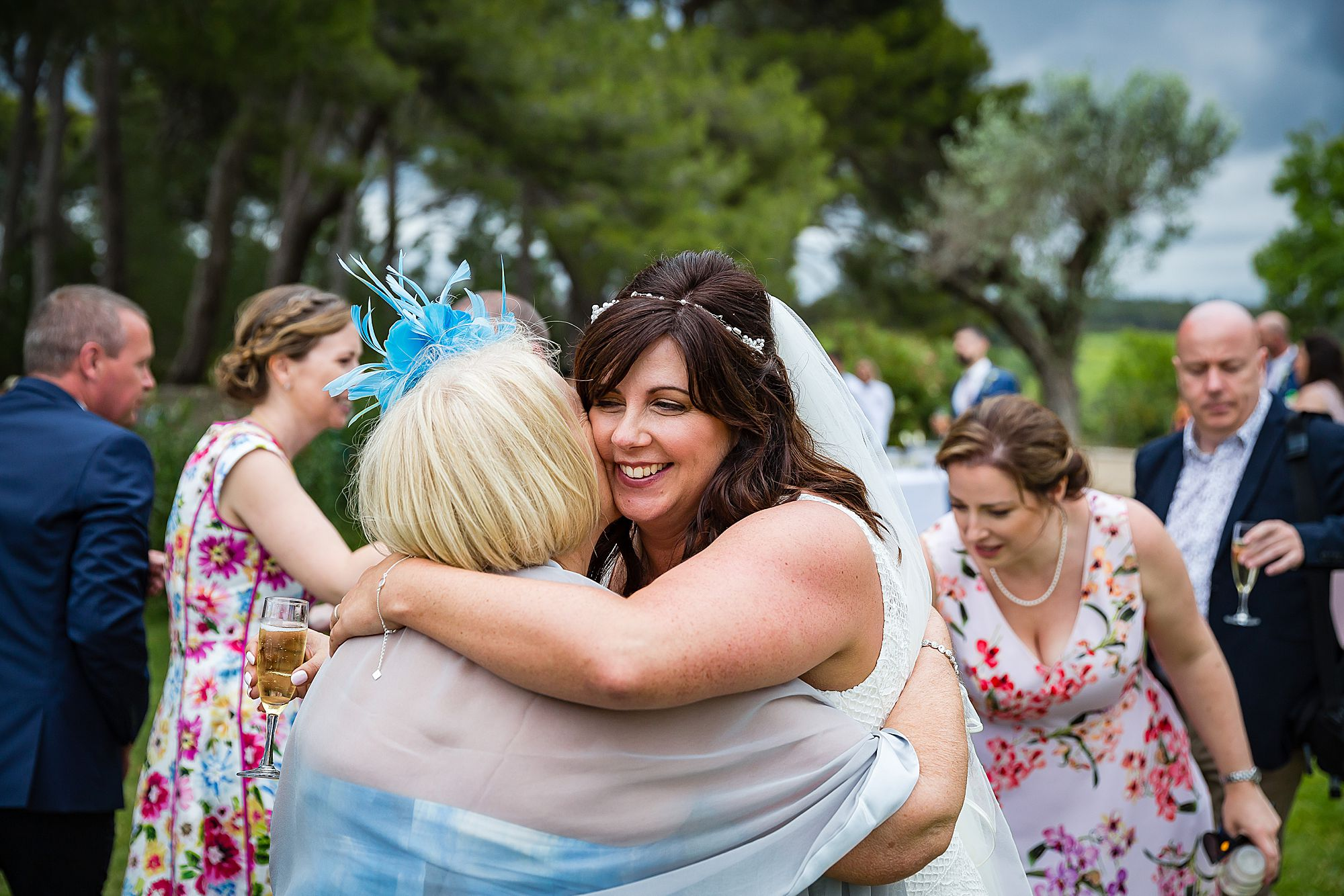 woman hugs bride