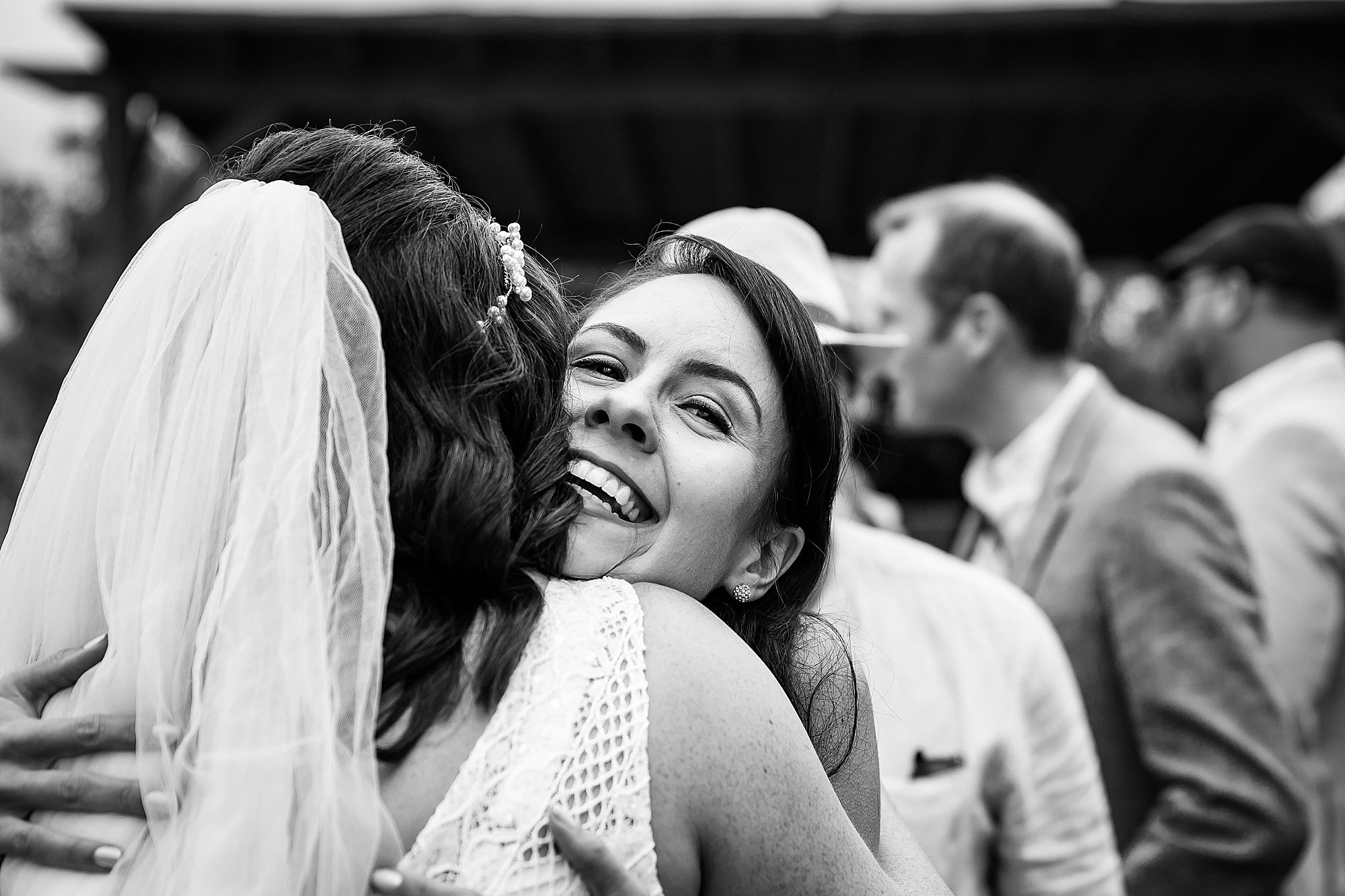 woman hugs bride at Domaine de la Grangette wedding
