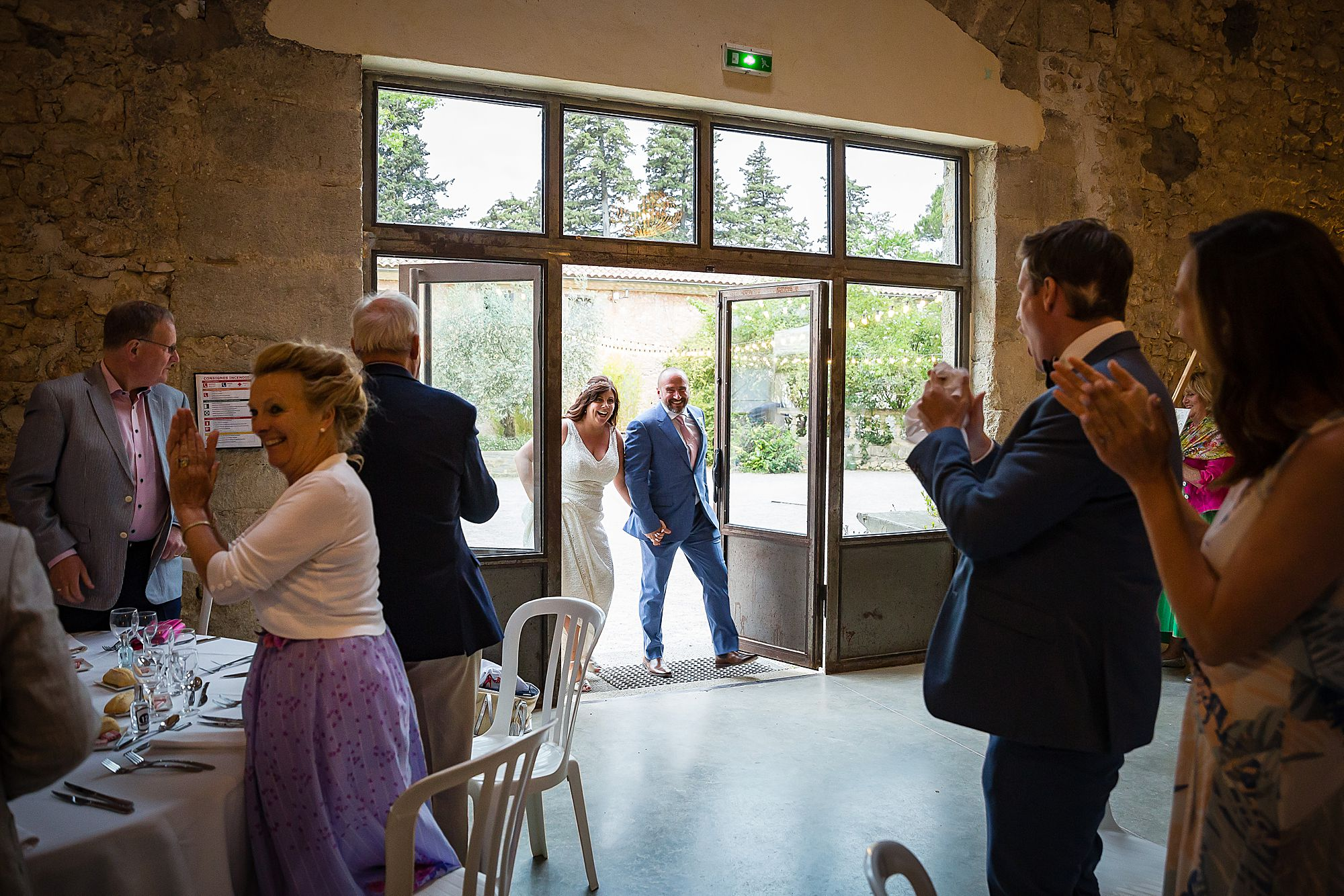 couple enter the salle at Domaine de la Grangette wedding