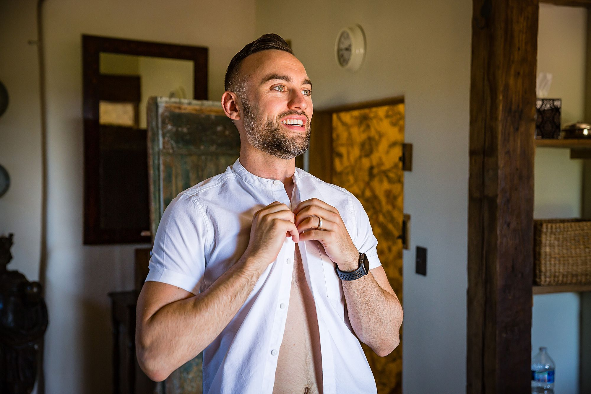 one of the grooms gets ready for his gay wedding in France