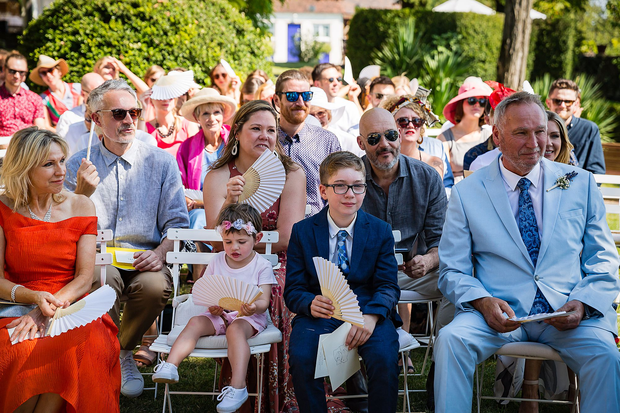 guests watch gay wedding ceremony in France