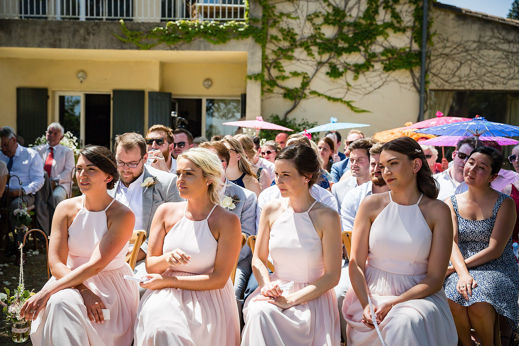 bridesmaids watch wedding ceremony