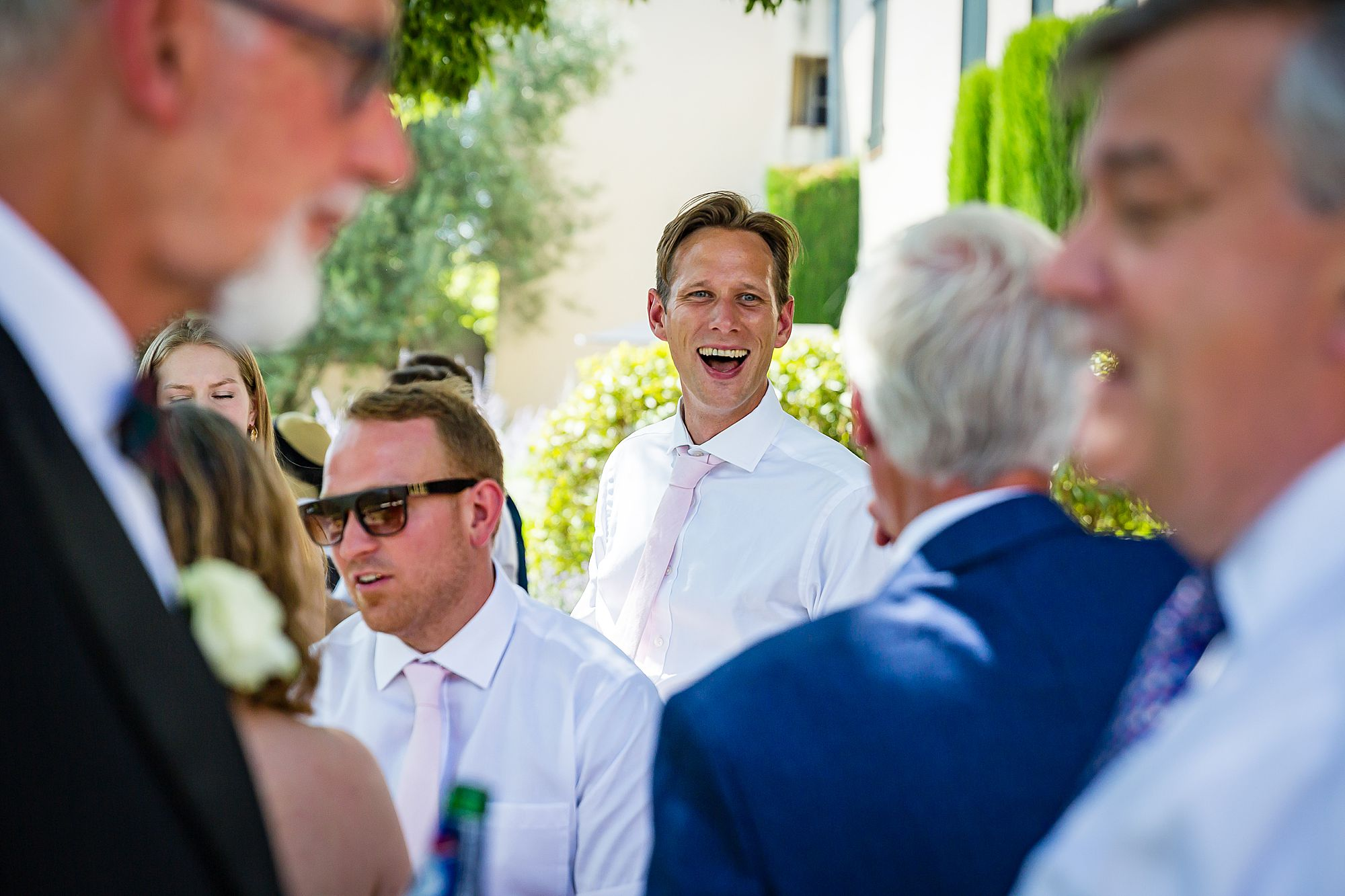 man laughing at Domaine Michaud Wedding