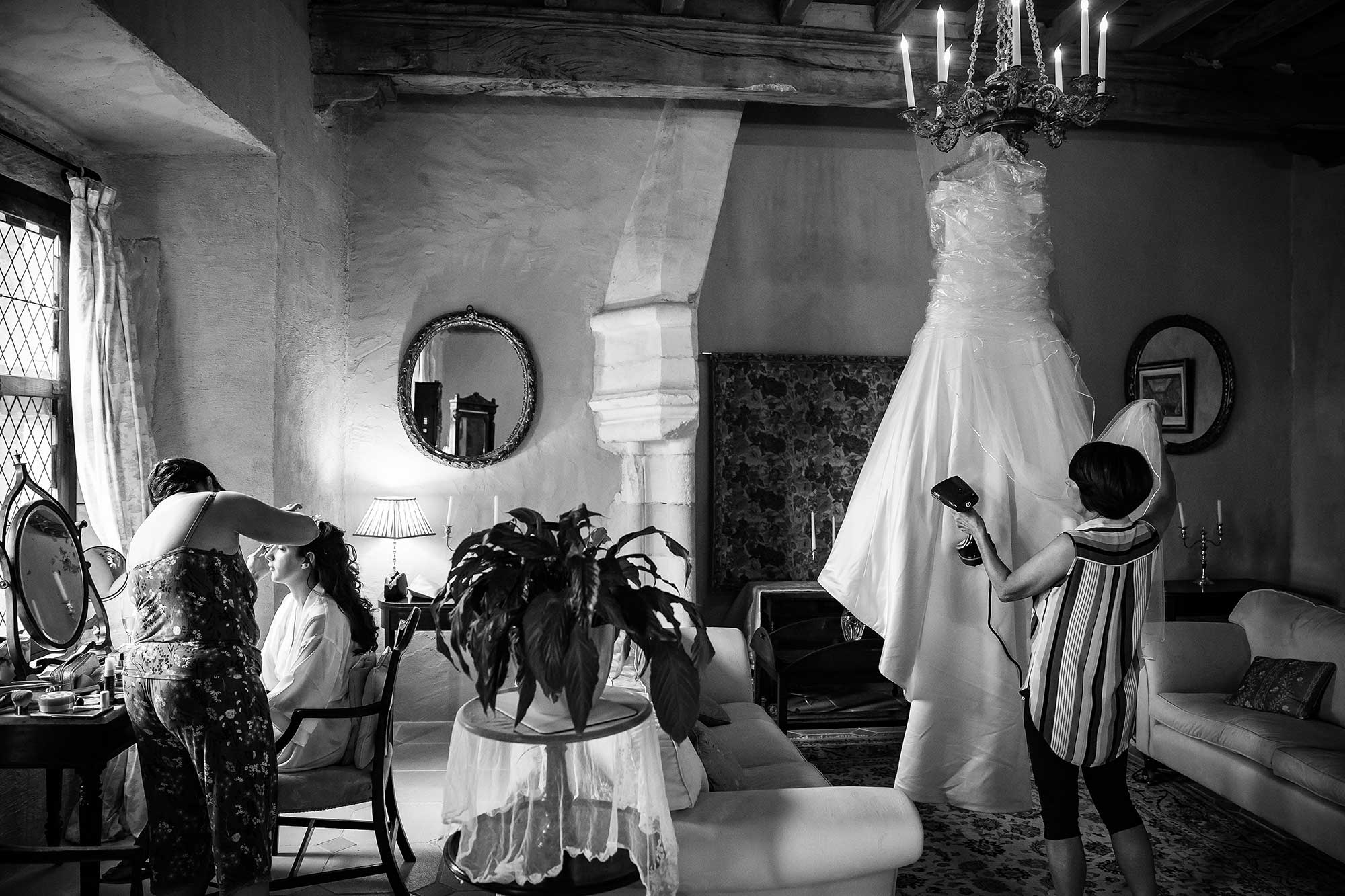 bride getting ready at chateau de brametourte