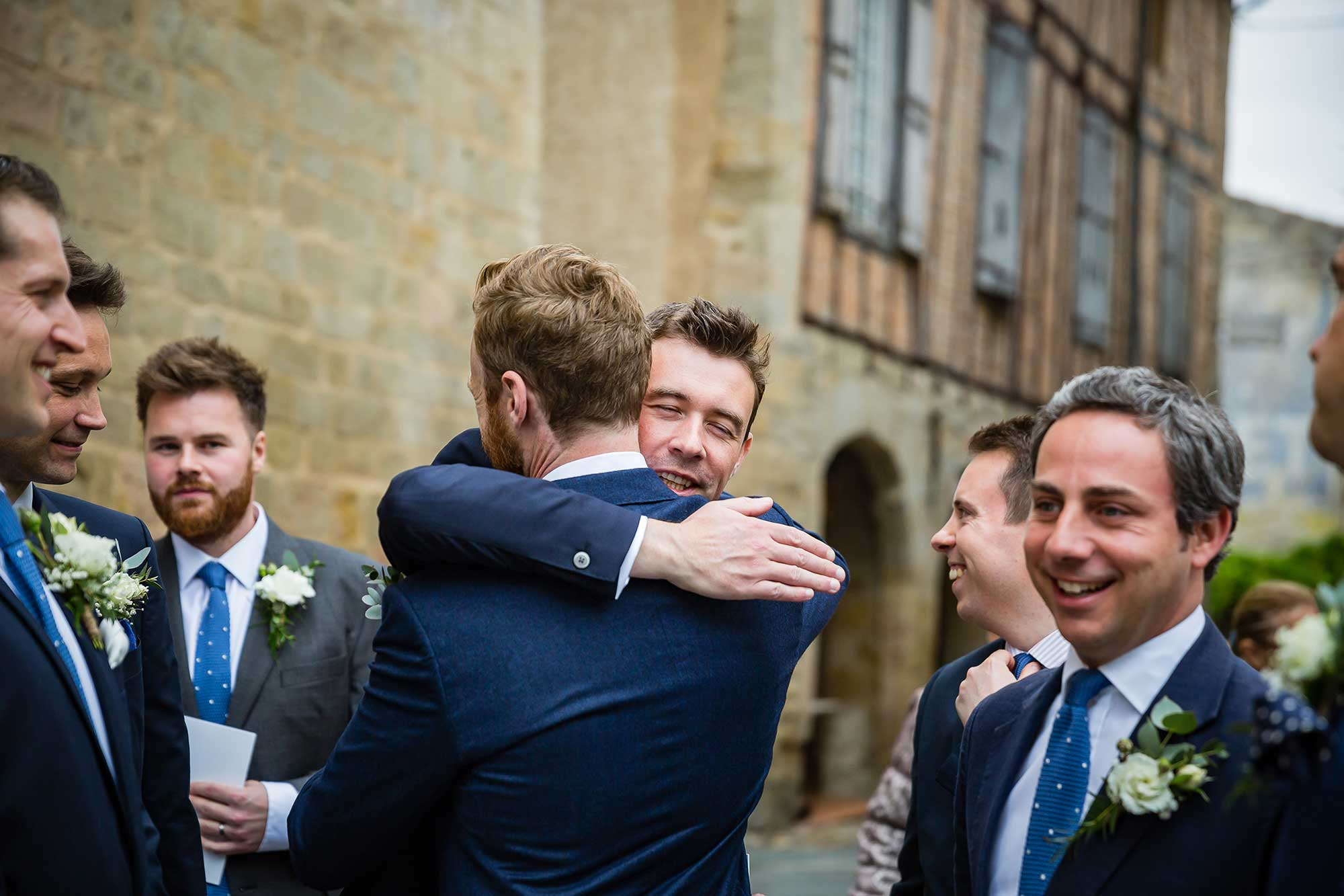 man hugs the groom