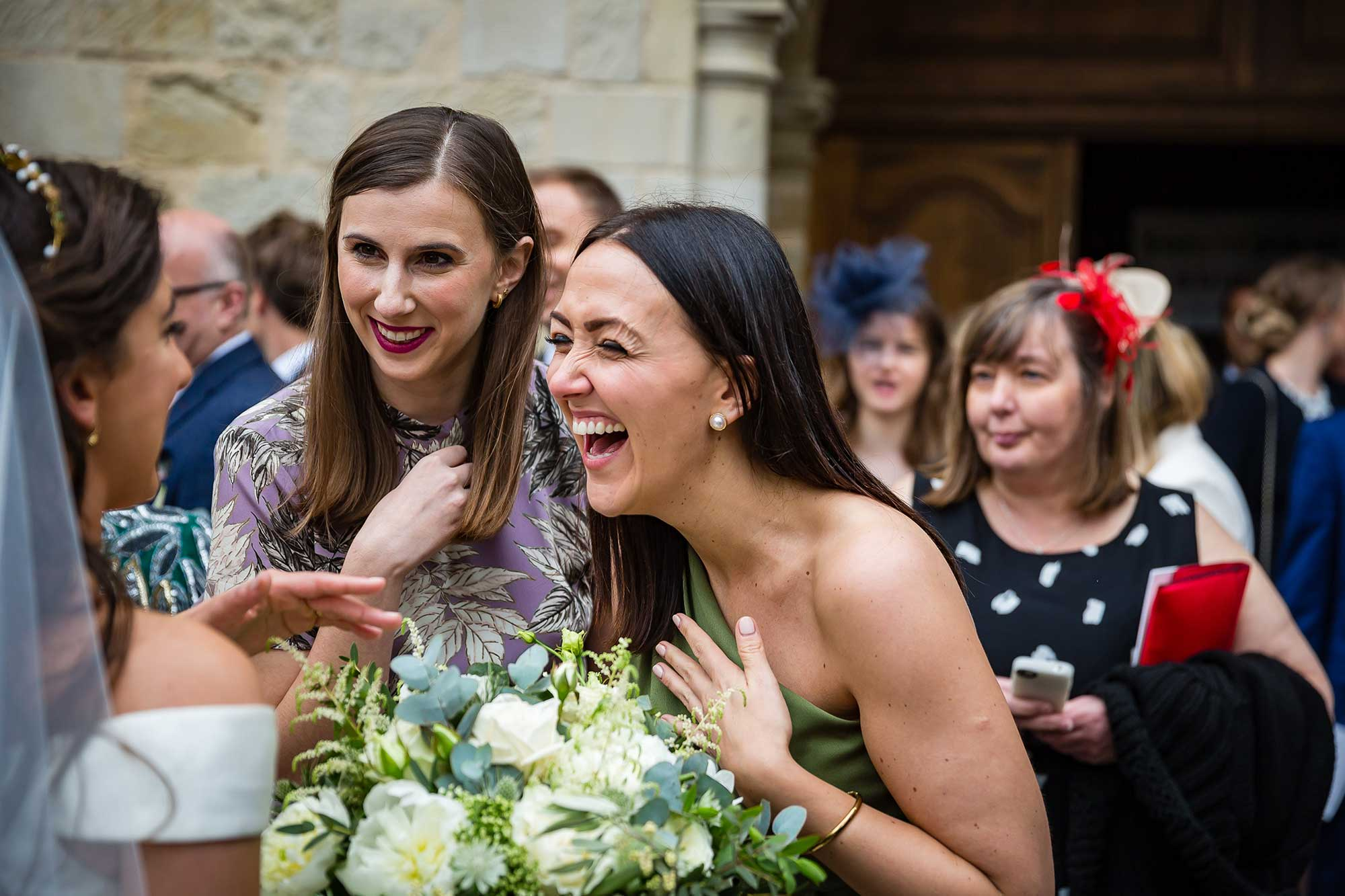 girls laugh with the bride