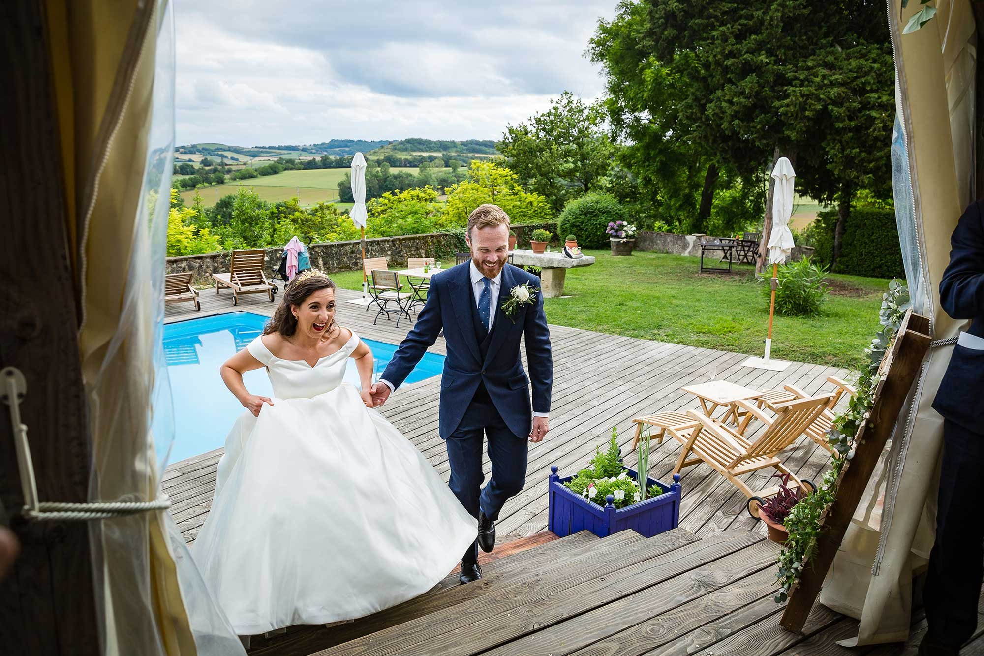 couple enter marquee at Chateau de Brametourte