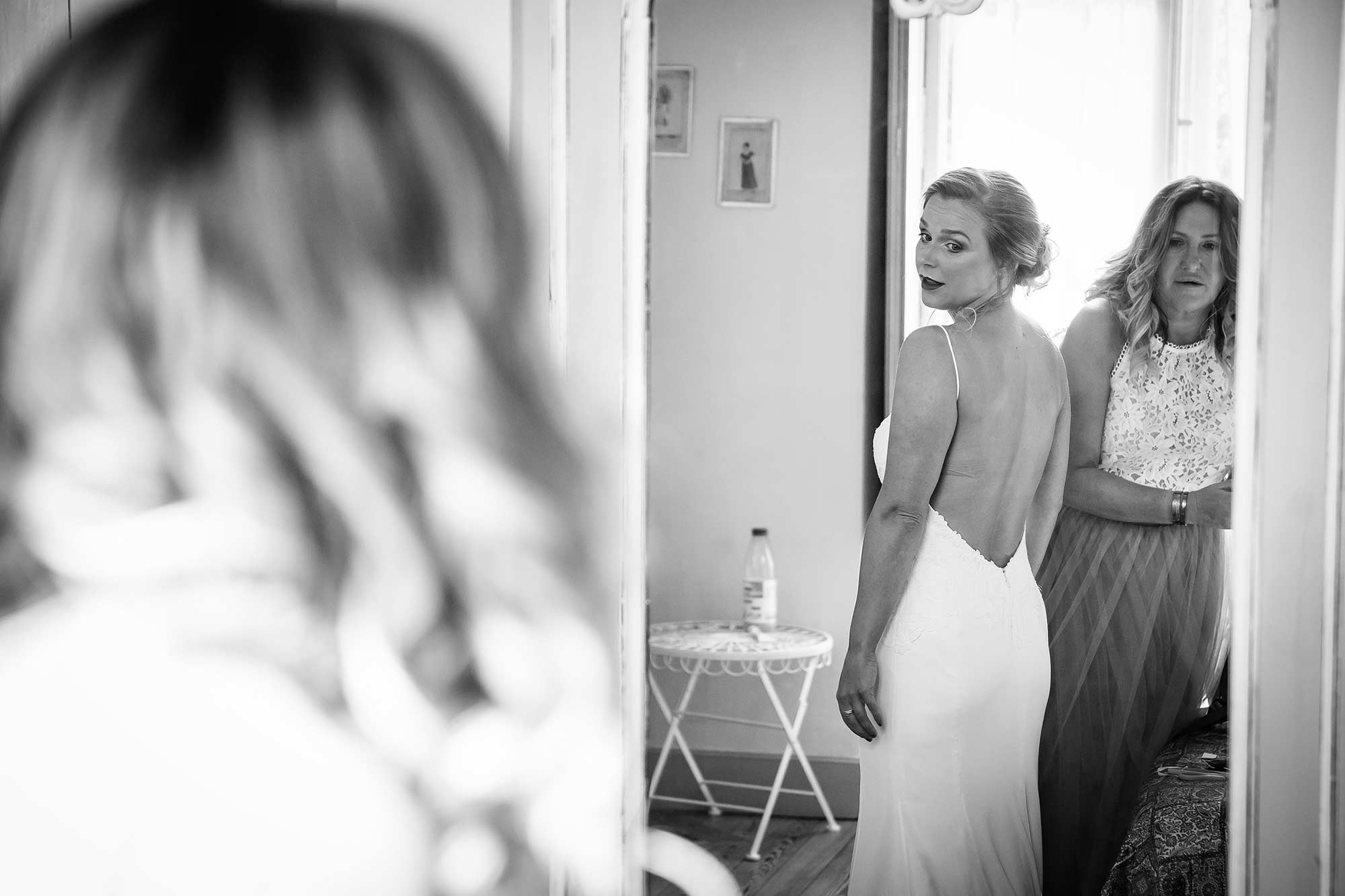 bride looks at herself in the mirror